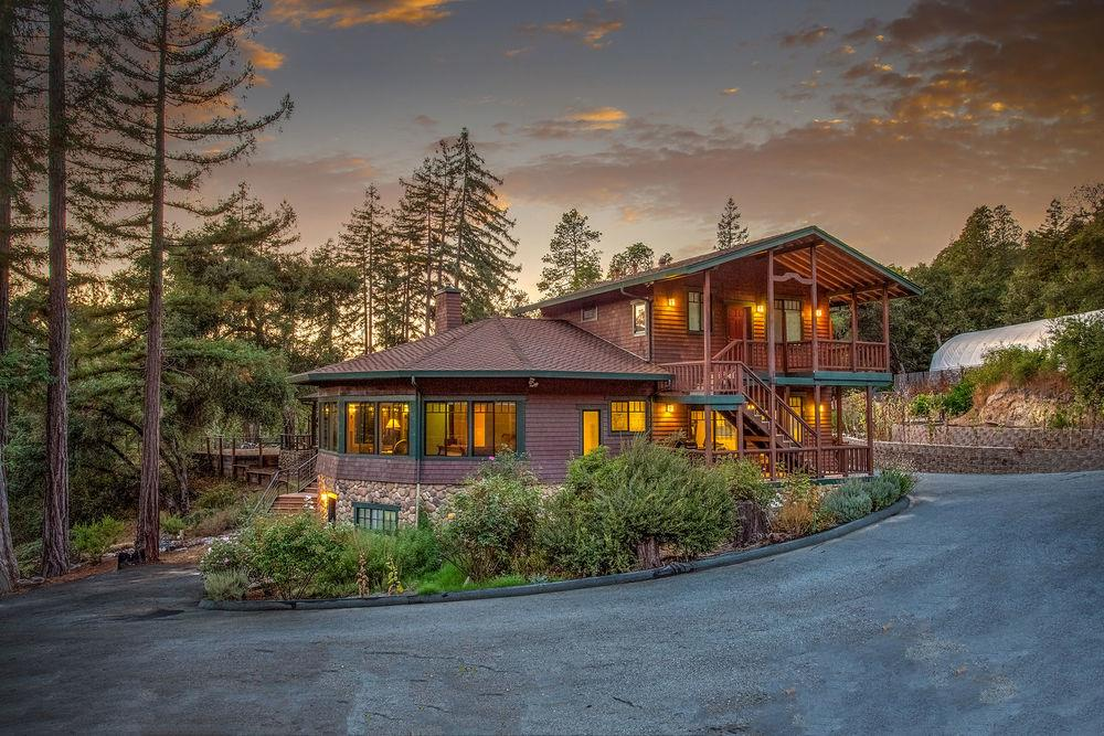 An estate that is truly beyond comparison, you will be mesmerized by this incredibly unique opportunity. The comfortable elegance of the architecture is perfectly accentuated by the diverse natural beauty of the surrounding 90+ acres of redwood, oak, madrone, & bay trees. There are also patches of manzanita that open up breathtaking views of the distant valleys & mountains. Newell Creek runs through one side of the property, & Sunset Trail of Quail Hollow Ranch is near the other side. You will immediately appreciate the attention to detail and craftsmanship that went into creating this very special home, and you can see every detail in our 3D virtual tour. There is a guest apartment attached to the main house, & a separate detached guest unit w/ it's own pristine alcove on the property. To top it off, there is a working organic farm w/ impressive infrastructure ready for your dreams to take form. With SU Zoning, there is potential for horses and vineyards. Youtube video available!