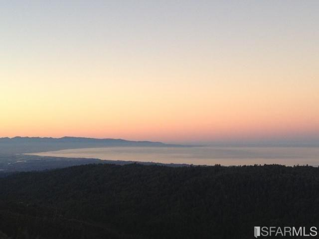 Expansive  Ocean View, Top of the Summit,  3000 ft elevation,  private,  and BBQ Patio,  Enjoy the zen, Quiet, Fresh air &  Full Sun Exposure, Beautiful sun deck,  surrounded by nature, Custom home, Open Living Room with wood burning stove,  propane heater, solar-powered home,  Good Soil,  ready for your garden, or possibly grapes,  off the grid , power, available  Los Gatos High,  10 minutes to Summit Store, Surf net internet Available, shared well, septic system,
