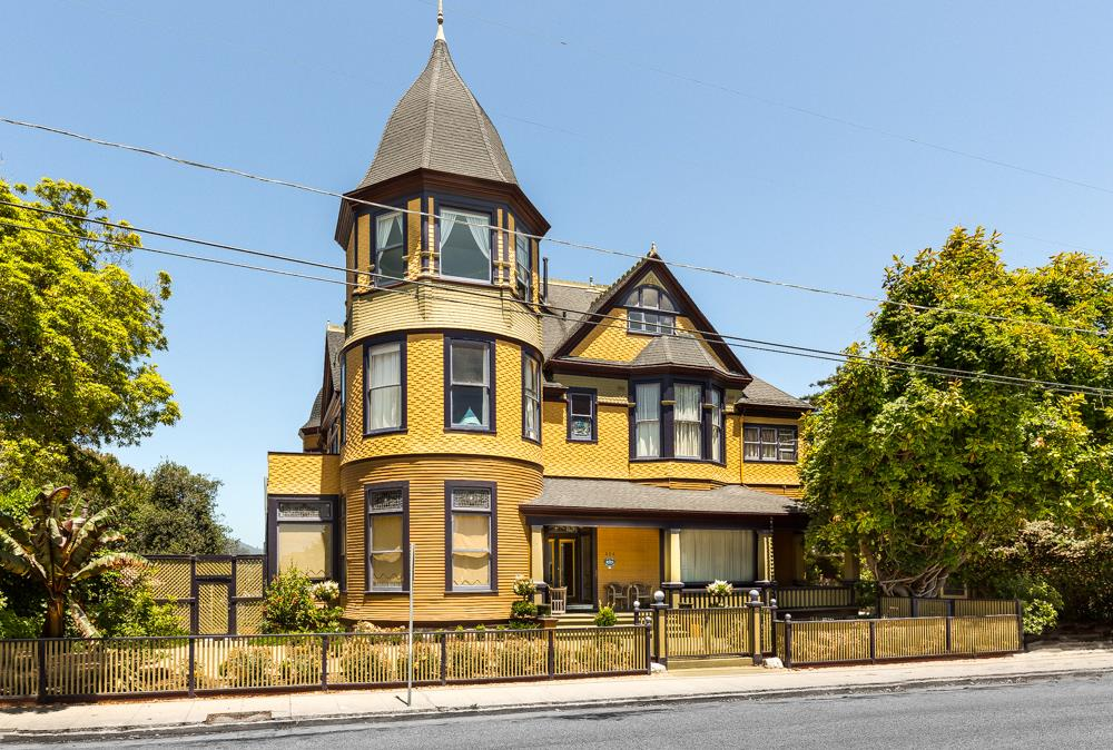 Known as  the Crown Jewel of Santa Cruz; this one-of-a-kind Villa was exquisitely designed by Thomas Welsh in Queen Anne Victorian style. The Golden Gate Villa was completed in 1891 with its original character immaculately preserved to this day, a monument to the lavish era of elegance and craftsmanship in which it  flourished. With over 10,500 square feet of living space, this magnificent residence features 10 Suites, 11.5 Bathrooms, including a penthouse overlooking the ocean and the city, a turreted carriage house, beautifully landscaped grounds & ample off  street parking. A Gold Parlor modeled after one of the rooms in the Palace of Versailles with a pure Onyx-faced fireplace and gold-plated chandelier, speaks well of the rest of the Villa. The grand entry with the sweeping stairway, intricately carved mantels of exotic woods, high ceilings with plaster rosettes, 20 museum grade Tiffany quality stained glass windows throughout the house, gilded ornamental detailing throughout.