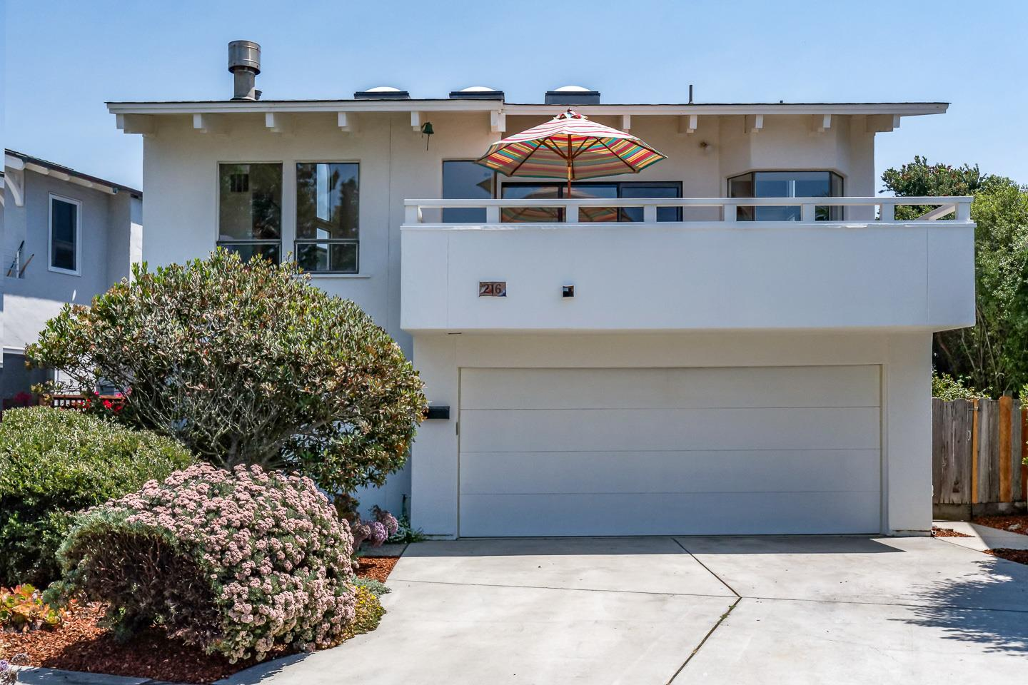 Sweeping WHITE WATER views.  This special property is three doors from the sparkling Monterey Bay and just across the way from Natural Bridges State Beach. Featuring an open floorplan that accentuates the glistening Pacific Ocean and dramatic sunsets from the kitchen/living room and spacious front deck, the home offers an upstairs with soaring ceilings and skylights, hardwood floors, fireplace and master bedroom with a walk-in closet.  Downstairs two bedrooms plus a family room equipped with its own sink and countertop open onto a patio with pergola and backyard with mature landscaping.  Enjoy walks on West Cliff, excellent surfing, whale, bird and people watching.  Bicycle to Courtyard Commons, New Leaf & a multitude of local restaurants.  Buyers searching for that unique opportunity to enjoy your life by the Bay...you have found it!