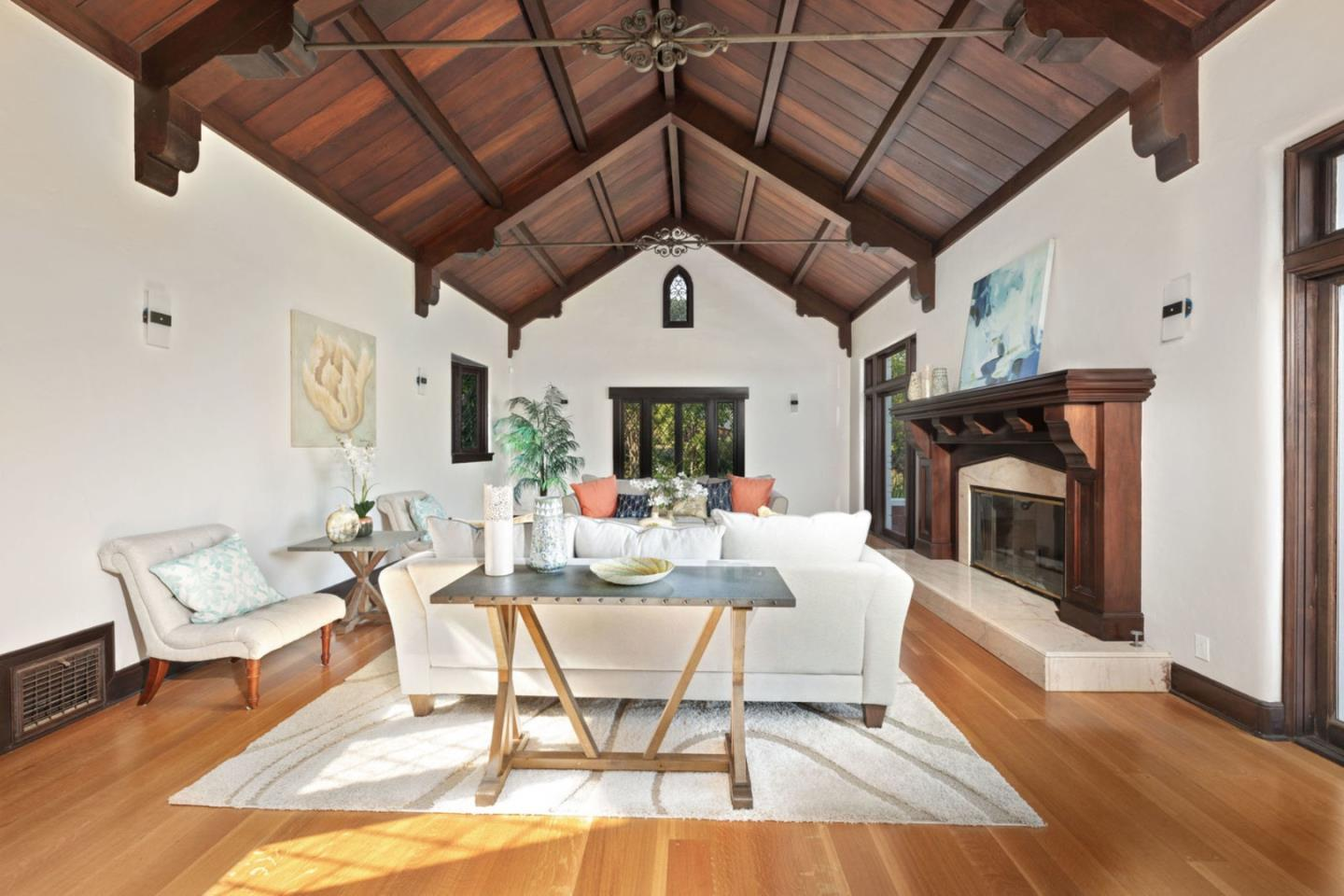 The perfect mix of classic elegance and modern comfort, this executive-style Tudor home, designed by famed architect William Weeks, checks all the boxes. Featuring exquisite exposed woodwork, meticulous attention to detail, vaulted cathedral-like ceilings, and original brickwork, all blended with a modern finish. All of this is set on almost half an acre in the prestigious Upper-West Side neighborhood. Wake up to beautiful ocean views, and the sun rising over the Monterey Bay. A small babbling brook, at the back of the property, adds to the serenity. Consisting of the main house, guest house, an attached garage with lots of workshop space and a second detached garage. The location and huge lot emanate a private feel while being only minutes from the shopping and attraction of downtown Santa Cruz as well as being an ideal location for Silicon Valley commuters.