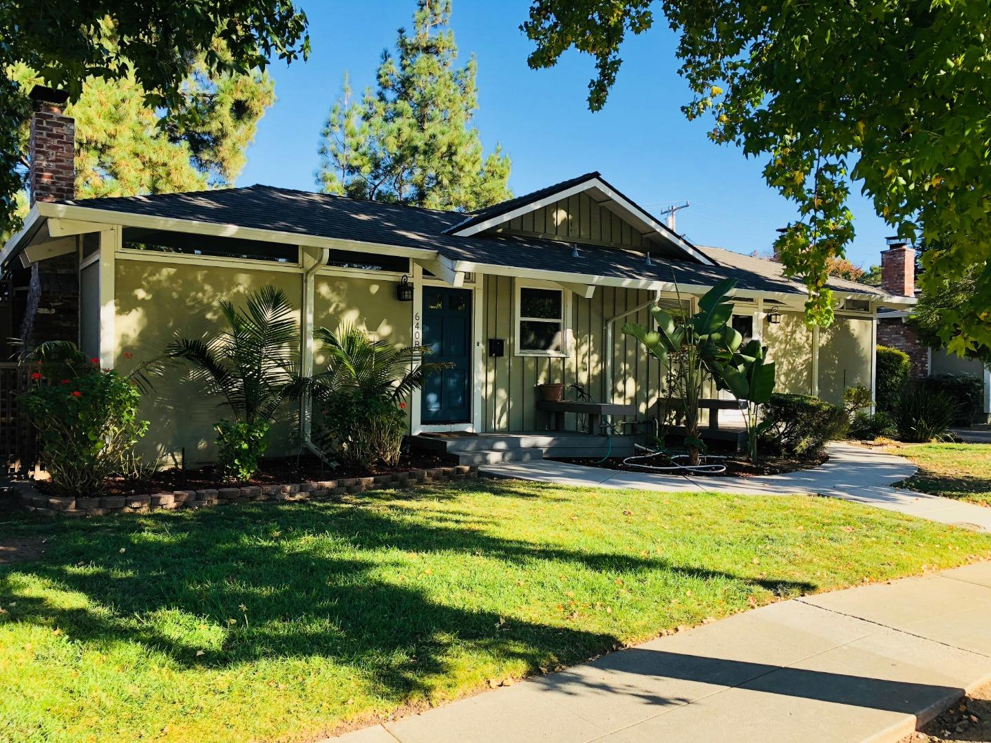 Located in the center of Silicon Valley, this quiet City of Campbell duplex home has it all!  Absolutely fantastic location, bright and beautifully updated, with vaulted ceilings, cozy fireplace, & remodeled bathrooms.  Upgrades galore including central air conditioning, cherry wood flooring, gorgeous patio decking, and custom stone pavers. Plenty of outdoor room to enjoy, relax and entertain. Wonderful, well-lit kitchen space and appliances. This home enjoys tons of natural light and a great floor plan, with a spacious living room, separate dining room and bonus enclosed patio room with skylight. Two bedrooms, master bedroom en suite is newly remodeled w/ new shower and vanity w/ dual closets, glass door to patio. Central hallway w/ indoor laundry nook with combo washer/dryer, plus another wonderfully updated bathroom. Close to downtown Campbell, Valley Fair/ Santana Row, San Tomas Expressway & major freeways.  This home is freshly landscaped & has its own carport & locked storage.