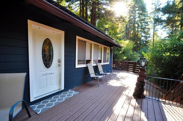 Warm wonderful home in a desirable neighborhood close to town, schools, minutes away from Silicon Valley. Easy access with gorgeous views of amazing redwoods. 3 Bedrooms and 1 bath on main level with a great family room, full bath and private entry downstairs great for family room, in law space or ?? This has been used by the 2 previous owners as a master bedroom suite. Newer appliances Newer Wrap around Trex Deck. 2015 Septic. Recently painted. Peace Serene and quiet yet with easy access. Attached 2 car garage with parking for ten. Room for oversized vehicle or RV AMAZING VALUE!!