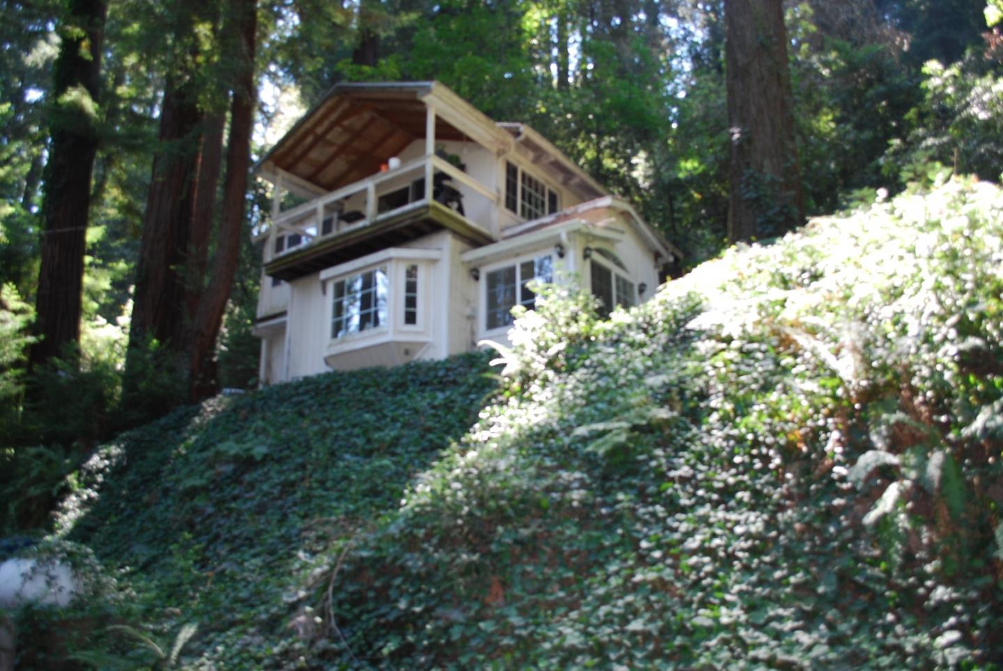 Beautiful and private cul-de-sac location within the Redwood Estates neighborhood ~ surrounded by redwoods. FIXER Property needs work ~ has great potential ~ This property is a diamond in the rough ~ Bring your contractors and plans for easy removal of red-tagged issues and renovations ~ Property sold 'AS-IS' ~ No Seller inspections ~ Home has a great foot print and is an opportunity for your ideas and plans to be realized!  Close to downtown Los Gatos ~ Excellent schools ~ Fun and active community!
