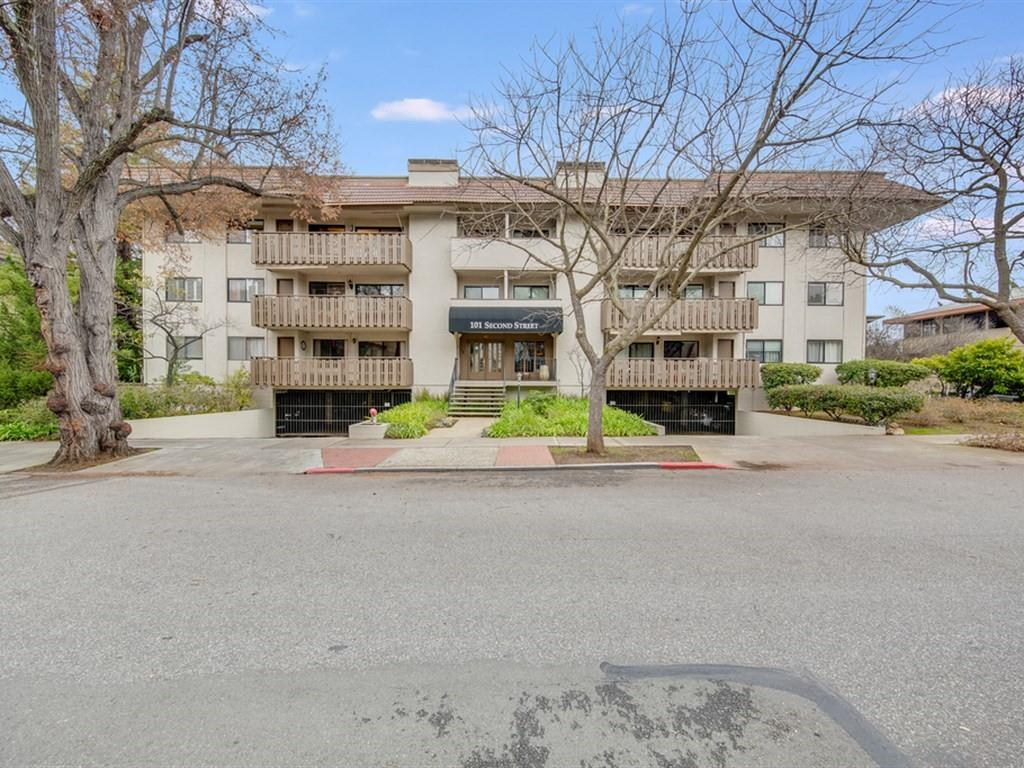 Heart of Downtown Los Altos.Penthouse style Condominium, 2 bedrooms and office which could be  3rd bedroom, + 2 full baths. Rare Top floor corner unit huge atrium/patio with northwest exposure and two balconies with southwest views of the mountains give this property tons of natural light.With approximately 1,521 Ft2 living space, plus the atrium/patio, make this property feel and live like its much larger.Thoughtfully remodeled and updated kitchen, high quality cabinetry and appliances. Open and flowing floor plan is perfect for entertaining. Master suite is truly special with amazing built in storage, two closets and remodeled bath with dual shower and rain, Elevator from the parking garage, +dedicated off-street parking, forced air heat and AC, Interior fire sprinklers, gas fireplace, community pool, extremely well managed HOA with low fees and high reserves. Enjoy everything Downtown has to offer, shopping, restaurants, parks, close to everything that makes Silicon Valley famous.