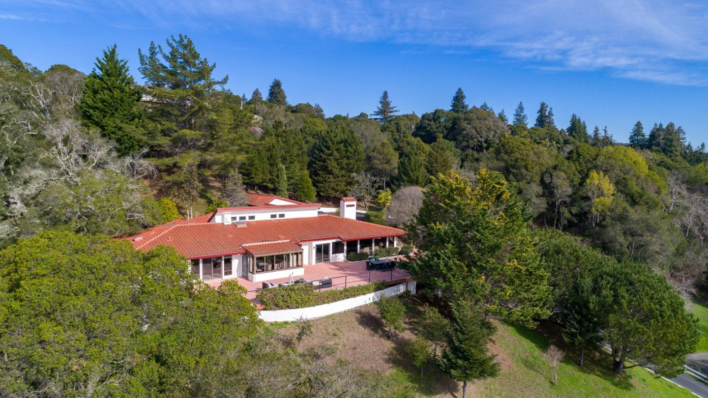 Panoramic Views of Ocean from Santa Cruz to Pacific Grove from the approx. 3000 feet of surrounding Patios & Decks. Just 7 minutes to Hwy 1, shopping, and the charming Soquel downtown. Single story, 4,400+ square feet of naturally sun-lit interior with 4 bedrooms, 3 Full Baths & 2 Half Baths (1 Half Bath in Garage). High Speed Internet provides this Private Retreat the convenience of daily life. Beautiful Forest experience and views along approx. 800-foot long Oak & Redwood studded Boardwalk with 3 Gazebos - Grab your favorite book and enjoy the serenity of the 10+ acres of property. This truly is a One of a Kind property with lots of upgrades and room for personal touches to your taste.