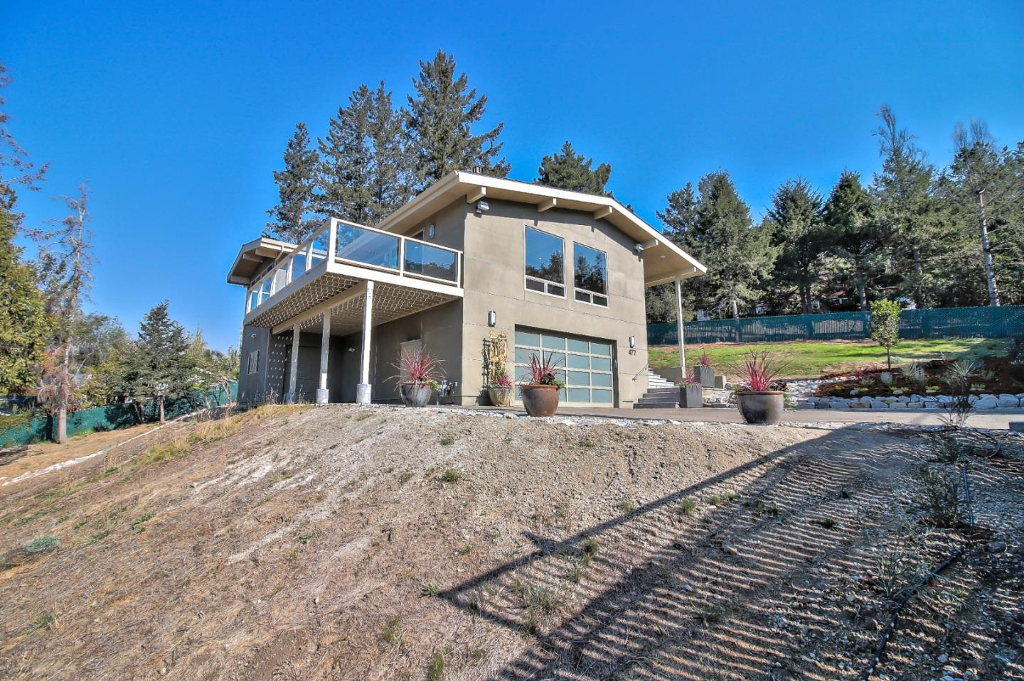 Brand new contemporary home with rental/guest house, perfect for multi-generational living, your au pair, or as a rental. With a focus on natural privacy, this brand new, gated Scotts Valley residence offers a unique balance between nature and structure that few homes manage to achieve. The contemporary floor plan is made up of light-filled spaces that link to the outdoors and captivating vistas. Just minutes to Santa Cruz and historic downtown Los Gatos. The main level Master Suite has a spa-like bathroom finished with imported Italian tile, and a door leading to a private deck with beautiful views. In addition to the homes striking living space, the professionally-equipped kitchen stands ready to cater gourmet meals on nearly any scale, offering a center island finished in quartz, custom Riff cut white oak cabinetry, and top of the line appliances. Access to coveted schools including the distinguished Brook Knoll Elementary - a Gold Ribbon Award Winner. Generous lot for your orchard!