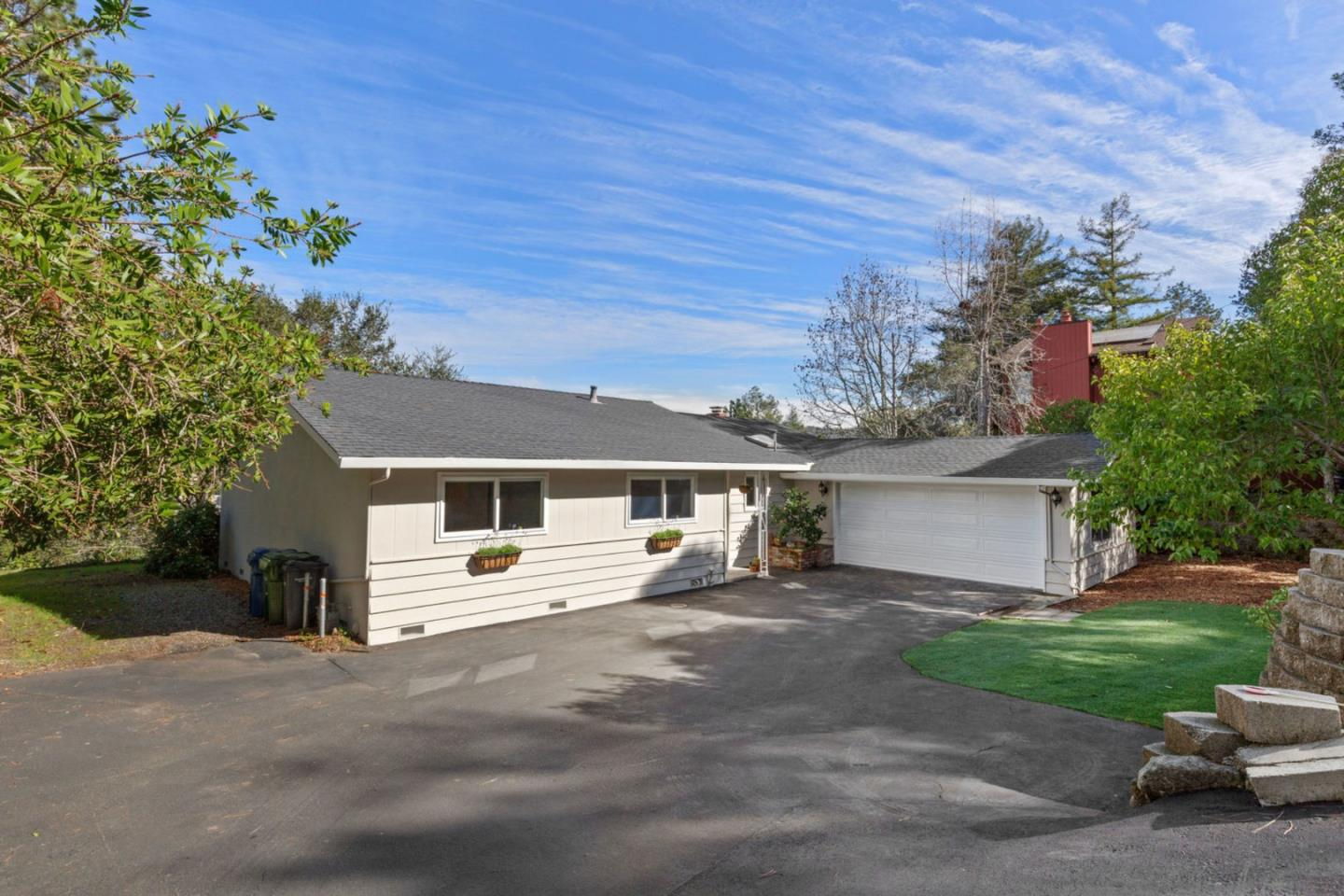 """Adorable single level home in the highly desirable Whispering Pines neighborhood. Featuring 3 large bedrooms, 2 full baths, and an open light-filled floor-plan w/ walls of windows to take in the spectacular panoramic views of beautiful Scotts Valley. Yes! It is possible to have sweeping mountain views and live in the middle of town. Originally built in 1965, this home has been tastefully updated over the years while still keeping its vintage charm. Warm oak hardwood floors & cozy wood burning fireplace w/ brick surround give the home the """"just right"""" feeling you've been searching for. The sliding glass door off the living rm connects to the huge rear deck which is perfect for entertaining or enjoying your morning coffee. Attached 2-car garage offers plenty of storage for your toys/hobbies, while the established, low maintenance landscape give you plenty of time to play or relax. Easy access to HWY 17, close proximity to town, & Award-Winning SV Schools! You're going to love this life!"""