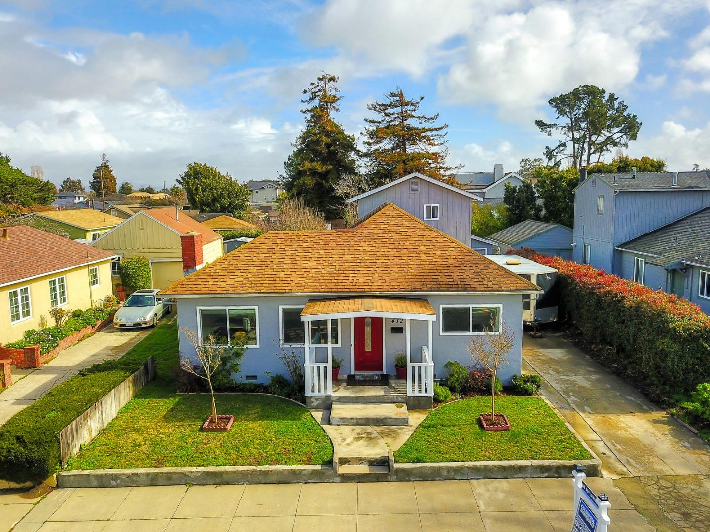 Opportunity knocks at a red door in this beautiful two story home. With 2,079 Sq.Ft. of living space on a 5,489 Sq.Ft. lot, this move in ready gem has 3 bedrooms, 2 full baths, a bonus room and a 2 Car Garage. The spacious kitchen has been remodeled to include custom cabinets, stainless appliances and skylights to give this beach home a modern feel. The stone fireplace and new carpets/flooring throughout are complimented by dual pane windows, in addition to the updated bathrooms and Tankless water heater. A covered Patio with a wood deck and a fire pit make the large private backyard perfect for entertaining. You are only blocks away from the ocean, which offers a 3 mile ocean-side path along W Cliff. Giving you access to a short walk or bike ride away to the world famous Santa Cruz Boardwalk, Steamers Lane surf spot, and the Lighthouse Field Park and Natural Bridges State Park. Location is EVERYTHING and this home provides that and so much more!