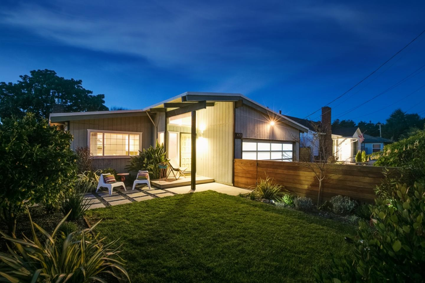 This attractive and modern home is in the coveted Opal Cliffs neighborhood, just a short stroll or bike ride to the best beaches of Capitola and the Pleasure Point area. Also close to a growing number of hip coffee shops, restaurants, tap rooms and all the conveniences of 41st Avenue. This desirable, single level home is artist inspired with mid-century touches throughout. The open concept living area features a modern gas fireplace insert, hardwood floors and a vaulted, exposed beam ceiling. Other upgrades include granite counters, maple cabinets, stainless steel appliances, double pane windows, nest security camera and thermostat, recessed lighting, contemporary garage door and much more. Outdoor living is outstanding as well with a south facing, professionally designed yard, custom fencing, avocado and orange trees, and an outdoor surfer shower. There is also parking for oversized vehicles, and a large two car garage with high ceilings with room for a workshop and all your toys.