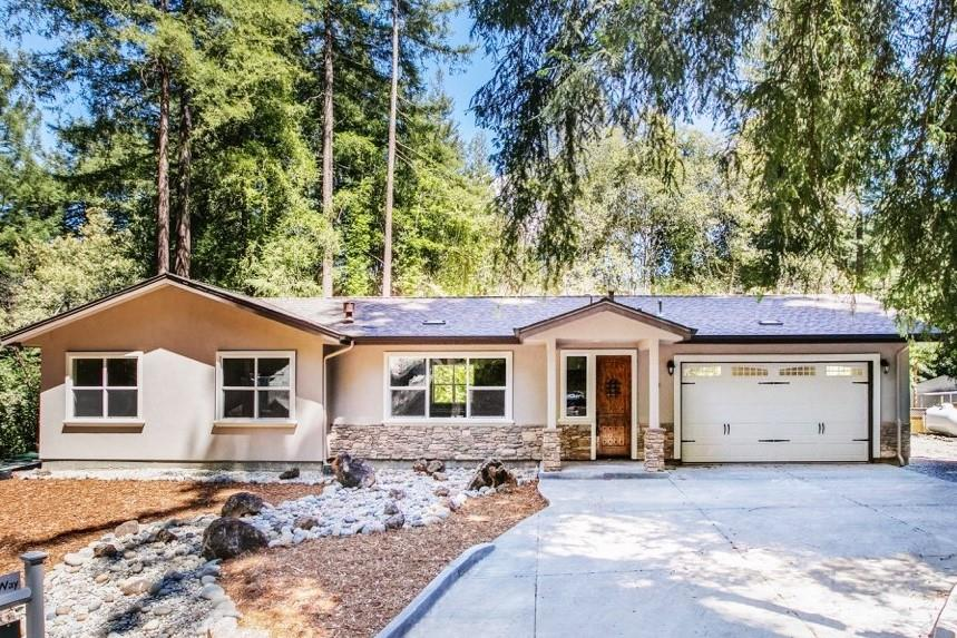 """Newly built, single level home minutes from magical Loch Lomond Reservoir. Follow meandering Lompico Creek to West Dr. Beauty and enchantment await you. Just under 1/2 acre of sunny solitude in a rural neighborhood. 20 minutes to the beach, 50 minutes to Silicon Valley, 0 minutes to the redwoods! Close to gourmet coffee and shopping, enjoy the feel of seclusion while experiencing """"small town charm and beach town fun""""! A/C, fire sprinklers, laminate flooring throughout, faux Venetian plaster wall finish, high ceilings, high doors, on demand hot water system, engineered septic system."""