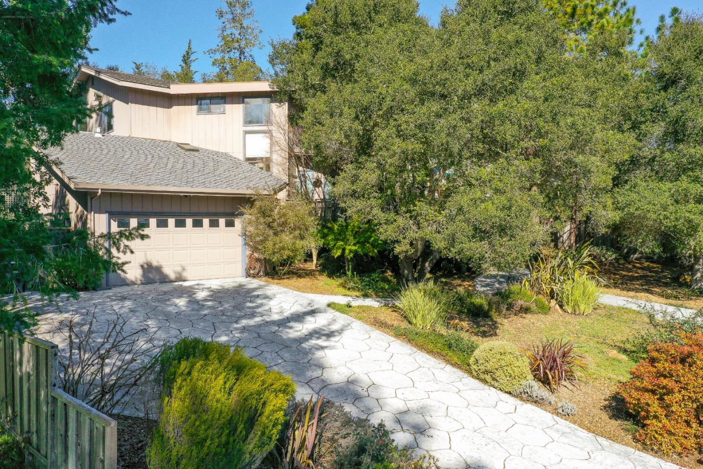 Welcome home to this beautiful Scotts Valley gem! Enjoy light and bright living with vaulted ceilings and an airy open layout. This home is the perfect spot to entertain with multiple decks and a magical garden with fruit trees on an almost a ½ acre lot!  The house boasts 3 large bedrooms and an office (potential 4th bedroom), 2.5 baths, an extra bonus art studio and loft area in garage. The living area is spacious and inviting with a gas fireplace to enjoy on cold winter nights. Enjoy the quiet and private neighborhood that is conveniently located near restaurants, shopping and parks. With quick access to the freeway for an easy commute to the heart of Silicon Valley the location is prime!  You must see this spectacular home to appreciate it!