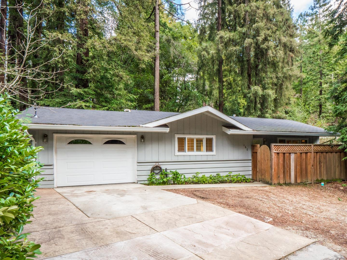 Great opportunity for a starter home or investor!  This sweet 2 bedroom, 1 bath home with 1089 square feet plus garage is charming and move-in ready! Hardwood floors,  dual pane windows, central heat, wood stove in living room. Nice floor plan with ample-sized bedrooms.  Bright and cheerful, with deck in back and room for enjoying a bit of gardening with beautiful mountain and river views.  Lives like a 3  bedroom, or 2 bedrooms plus a separate family room.  Just two miles north of quaint downtown Boulder Creek. A terrific commute location to Los Gatos/San Jose/Silicon Valley.  Easy access to Highway 9. Great San Lorenzo Valley schools.  Don't miss this one!