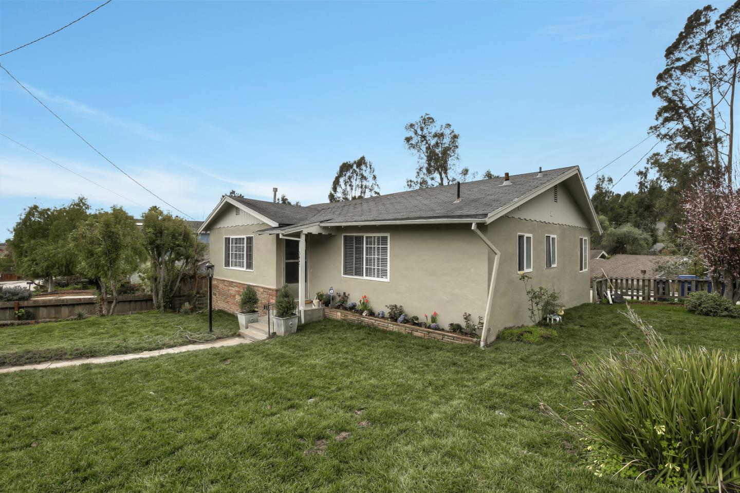 Single level home on a corner lot in a great neighborhood in Soquel!  Sunny spot with large fenced yard and off street parking.  The home has hardwood floors and double pane windows.  The kitchen has been updated with marble counter tops and newer cabinets and has a breakfast bar.  Master bedroom with bathtub.  There is a family room and a living room with fireplaces.  This is a quiet location yet close to town and amenities.