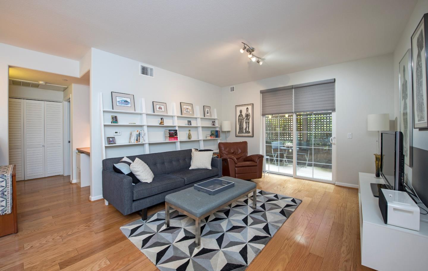 Built in 2009 and located off the inner courtyard of the complex, this light and bright 2 bedroom 2 bath ground level luxury condo provides a peaceful and private setting along with building amenities including pool/spa, gated lobby access, 2 secure underground parking spots, children's play area and storage. Gourmet kitchen with granite counter tops, stainless steel appliances, breakfast bar, open living room with automatic shades, patio, air conditioning and office area.  The spacious master suite provides dual sinks, oversized tub and large walk in close. There is additional street parking on Los Altos Ave with secure access to the complex. The complex is conveniently located next to bus routes (includes one to Stanford), tech company bus route adjacent, commute routes, schools and shopping.  Outstanding Los Altos Schools round out this fantastic opportunity.