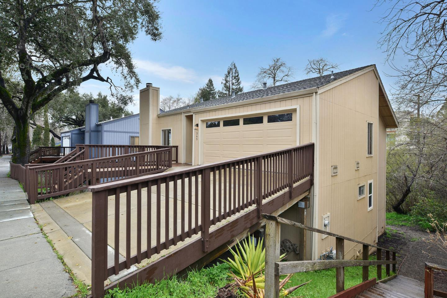Perched well above a beautiful creek this wonderful family home offers a tremendous bang for the buck.  Do you have a large family, work over the hill or are you working at/ going to UCSC?  Well, if so, this house could a great fit for you!  Located on a private cul-de-sac conveniently close to Downtown Santa Cruz and freeway access the natural light flow and privacy will be very difficult to replicate in this price range.  Recently upgraded with new lighting, hardware and carpetthe canvas is blank and ready for the next owner to add their own color!