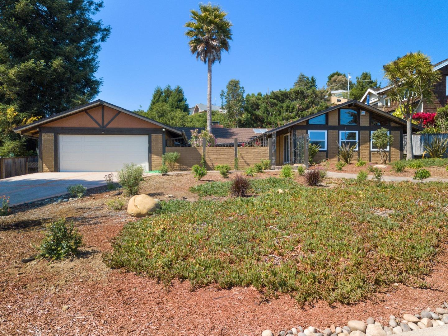 Ocean View, Single story,Carmel inspired Hacienda on a flat usable (12,196 sq ft) lot. Bright and open home with 2088 sq,ft., 4 bedrooms (3 w/lofts), 2 full baths, and a 2 car detached garage. New expansive concrete driveway, and RV/boat parking. New custom pavers lead from the driveway and street culminating  in the gorgeous private courtyard, perfect for entertaining.The home also boasts vaulted ceilings throughout, beautiful granite counter tops, new dual pane windows, forced air heating, remodeled baths, skylights, home security system, and reverse osmosis water system. Wonderful and desirable location with easy walks to the beach, convenient shopping, restaurants, and Seascape golf course. From the great room you can relax to the sound of ocean waves crashing on a quiet evening while enjoying the warmth of your dual sided fireplace. Rio Del Mar Elementary (A Blue Ribbon School) is a short walk away! Bring your inspiration and make this your dream Home!