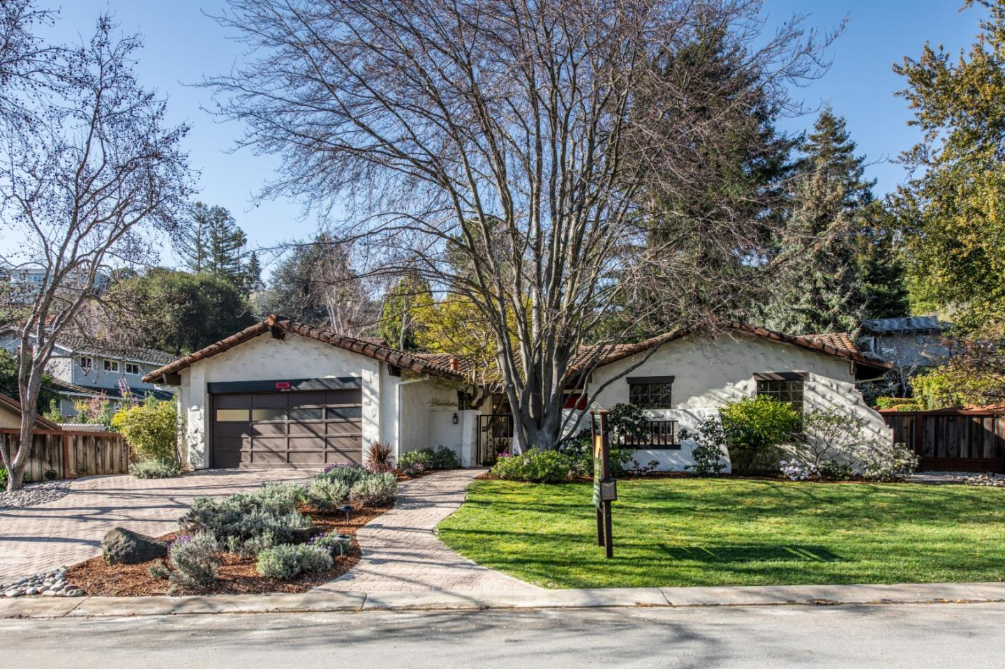 Charming Spanish Ranch on a quiet street close to downtown. Cozy front and back courtyards. Landscaped gardens with mature trees. Near to Google, Apple & Stanford. Award Winning Los Altos School District.