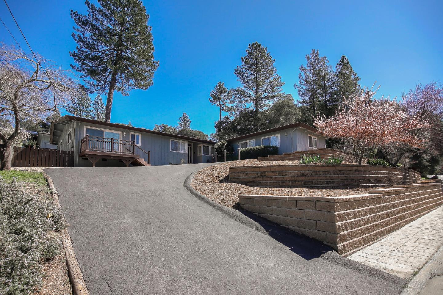 Located in the highly sought after Hihn Road area of Ben Lomond, this home is set on a sunny double lot with mountain views. The fully landscaped yard features low maintenance mature plants, impressive hardscaping with terraces, patios, and paths that lead to a garden shed and workshop. There's an abundance of parking with two driveways including space for oversized vehicles as well as a large two car garage. With over 2200 square feet, the single level floor plan is ideal with an easy flow between indoor and outdoor living. Highlights include spacious bedrooms, an inviting living room, large dining area and kitchen, covered outdoor patio, and a huge family room with an office nook and wet bar. To top it off, there's also a bonus room attached to the garage perfect for your hobbies or a quiet office space. Fantastic commute location with easy access. Close in country at it's best. City water and natural gas. Excellent Schools K-12. **FIRST OPEN HOUSES SAT & SUN 12-5pm**