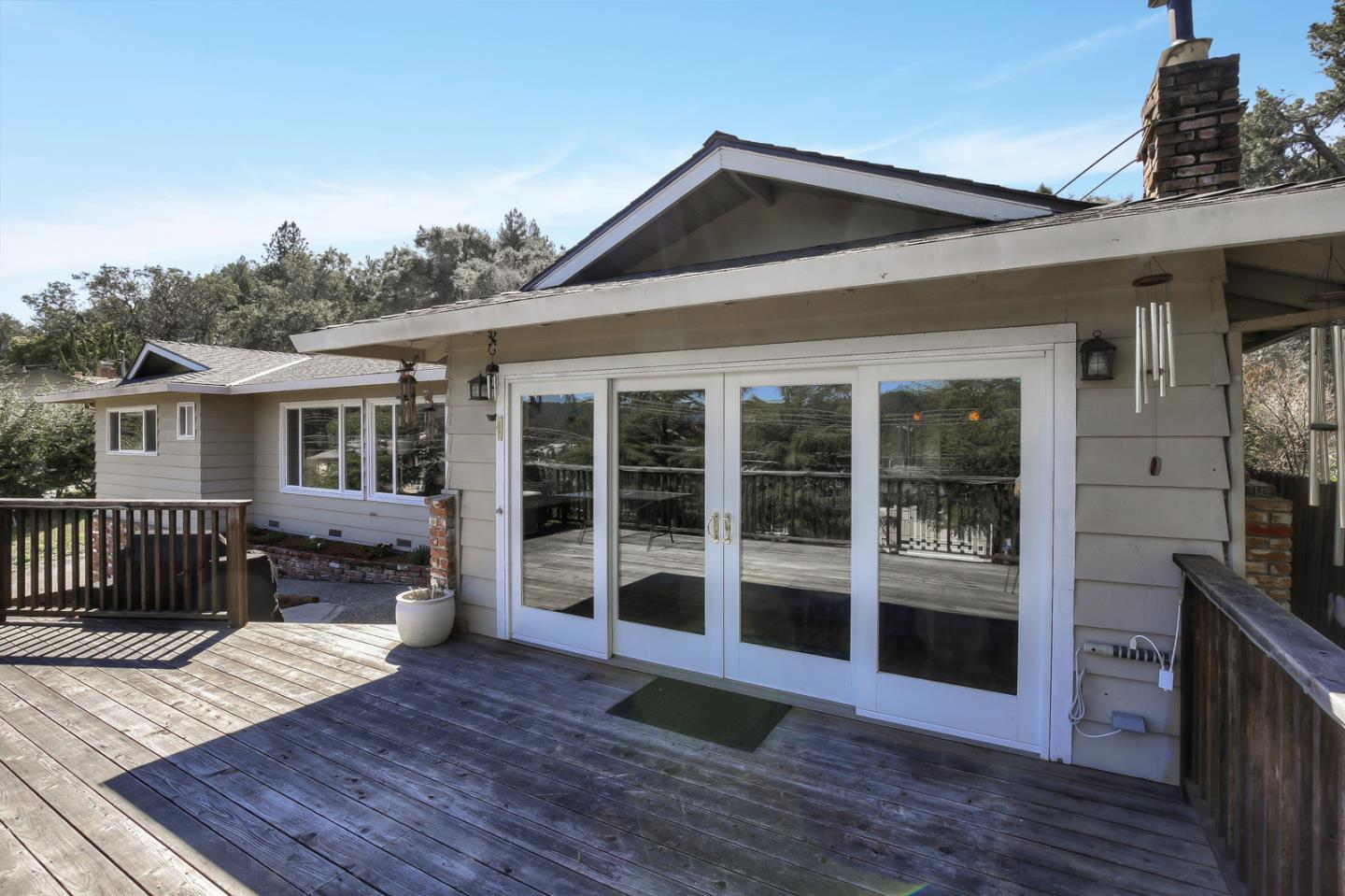 Beautiful updated Scotts Valley single level home with a spacious bonus family room that could easily be used as a 4th bedroom without a closet but lots of room to add one.  The home has been well maintained with a gorgeous updated kitchen with 5 burner gas cooktop, double ovens. stainless appliances, granite counters, and a breakfast bar.  The dining area looks out over Scotts Valley with a beautiful large deck for entertaining and BBQing.  The grand living room has vaulted ceilings and large view windows. The master bedroom suite is a relaxing oasis with a remodeled bathroom featuring granite and hand-hewn marble, a sumptuous soaking tub and large vanity w/ double sinks. Indoor laundry, pantry, updated vinyl windows, furnace and AC replaced in 2012 plus oak and bamboo floors. Large 2 car garage good sized w/ new garage door.  Plenty of off street parking on this very generous sized lot.  Enjoy walking to Scotts Valley shopping,  parks and festivals from this beautiful home.