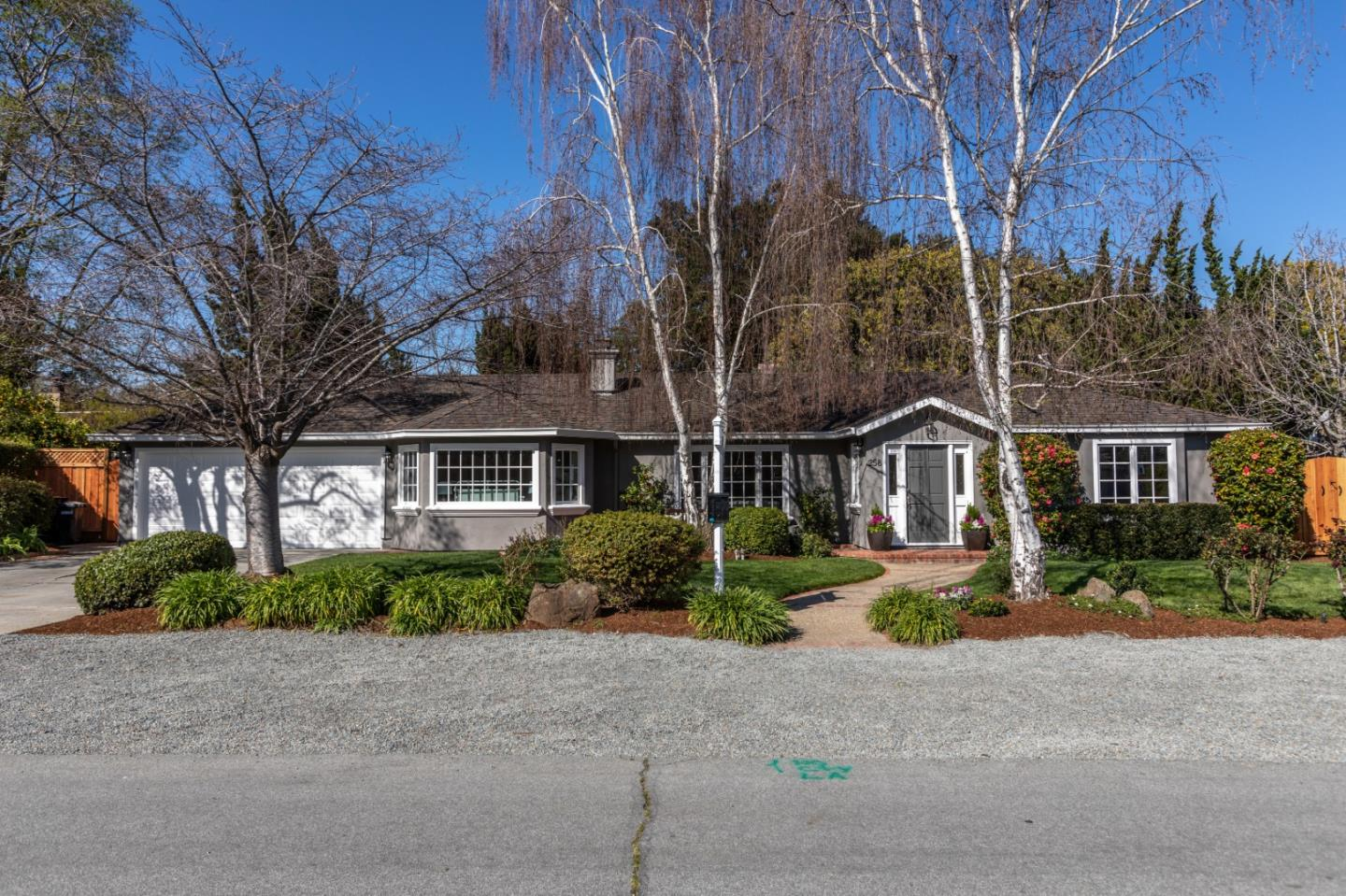 Don't miss this true Gem; located in desirable North Los Altos. This beautiful single level home has 4 bedrooms and 3 full baths in the main house and a full bath in the guest/pool house. Situated on a quiet street and minutes from downtown Los Altos, this family home is conveniently located near top rated Almond Elementary and Los Altos High Schools. Entering the marble foyer, you'll love the flexible floor plan, large open living spaces, the bright living room, formal dining room, family room/kitchen that is perfect for entertaining. Two sets of French doors lead to the park-like backyard on a private over-sized lot surrounded by mature trees. The home is freshly painted and accentuated with refinished hardwood floors and new carpets in the bedrooms. Children and guests will enjoy the charming pool/guest house, with French doors, full bath and bedroom; ideal for a playroom or overnight guests.