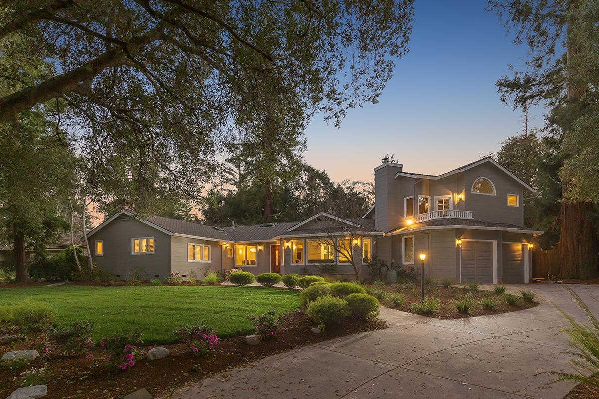 Beautifully remodeled elegant home in Woodland Acres in Los Altos. Bright and light-filled 5 bedroom floor plan with private guest suite upstairs. Elegant living room with coffered ceilings, bay window, built-in cabinetry and fireplace. Large chef's kitchen with granite counters, grand island, spacious dining nook and verdant views of the expansive backyard. Tremendous open family room with vaulted ceilings, large fireplace & french doors to to the lovely patio and lawn. The upstairs suite with cathedral ceilings is ideal for guests or an au-pair. The master suite has vaulted ceilings, large walk-in closet & lovely en-suite bathroom with jacuzzi tub & separate shower. The private backyard yard boasts beautiful lawn, brick patio for entertaining, gorgeous gardens and a delightful children's playhouse. Excellent Cupertino schools  & nearbyprivate schools. Outstanding location, close to groceries, library, parks, hiking,shopping & dining.