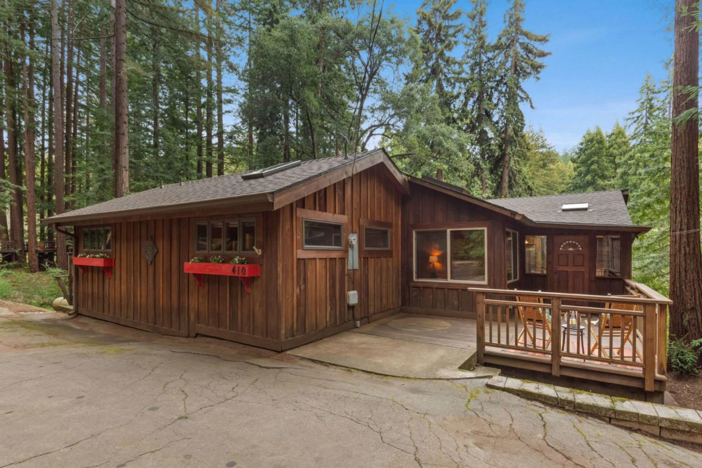 Your Polished Mountain Hideaway ~ This two bedroom, two bath 1,686 sq. ft. home sits on a sunny 12,850 sq ft lot and has many beautiful features, including knotty pine wood paneling in every room, brand new carpeting and an abundance of light from the multitude of windows and skylights throughout the home. Luxuriate in the spaciousness felt by the beautiful open beam ceiling and let your imagination be your guide when furnishing this flexible floor plan, this home can absolutely adapt to fit your unique needs. When you arent luxuriating in your new home, you can indulge in the wonder of outdoor living with your large fenced in yard, patio hot tub! Ample parking is provided by the carport with space for two vehicles, turn the detached shed into an extra office or workshop, and enjoy the comfort of the inside laundry area. This is mountain living at its finest.
