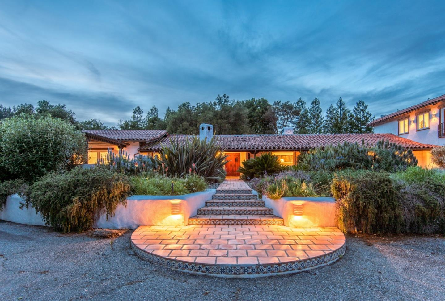 Just five minutes to downtown Los Gatos and only a half mile up Bear Creek Road. Natural privacy emanates from this one of a kind Spanish Los Gatos estate, offering a captivating interplay between nature and structure that few residences manage to achieve. Imagine the very best of everything presented in a singular setting-where the finest materials combine with dazzling artistry and craftsmanship to create an environment of textures, patterns, and colors that delight the spirit. Casa de los Suenos is that place. This spectacular estate is a triumph of architectural design and exceptional craftsmanship that unfolds on approximately 2.5 glorious acres in the hills of Los Gatos. Culinary kitchen with Custom wood cabinets and top of the line appliances. A Separate guest house and separate studio perfect for home office, gym, or art studio.  Approximately a  1400 square foot over sized four car garage. A self contained attached fully equipped apartment. Only minutes to downtown Los Gatos.