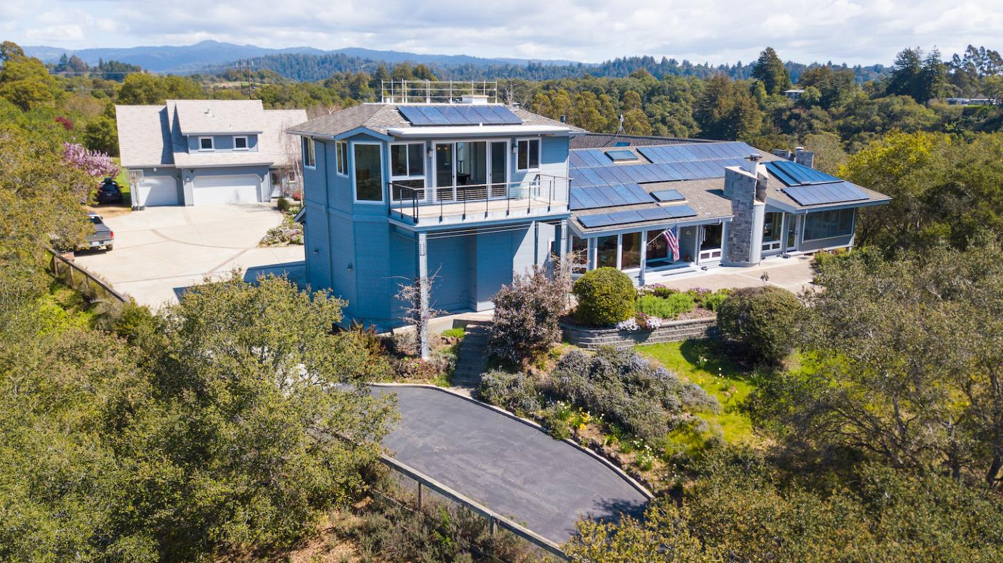 This sunny 13.6 acre horse property with custom 5,000+ square foot home plus guest house is not to be missed! Sitting on top of its own private hill, this stunning estate has ocean views and is just a few minutes outside of town. This house truly has it all - top of the line theatre, game room with panoramic views, paid off solar system, automatic skylights, 3 car garage, recirculating hot water pump, and automatic back up generator. Guest house includes workshop, extra laundry room, and exercise room! Multiple sprawling pasture areas could be fenced for animals, and the 6-stall horse stable is fully plumbed and has electricity as well. Come take a stroll amongst mature gardens and fall in love with your own slice of paradise. Sellers are willing to include much of their custom furnishing with the sale. Call today for a full list of all property specifications, upgrades, and bonuses!
