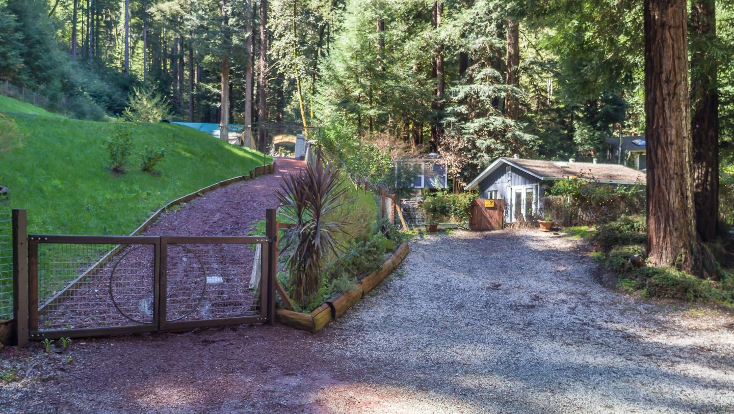 Magical oasis set privately surrounded by gorgeous redwoods on almost 5 acres in charming Felton. Easy, flat driveway onto this property and only 10 minutes to downtown Santa Cruz or 3 minutes to adorable downtown Felton. Enjoy the charming, renovated studio with a modern flair while you work towards getting plans and permits to build your dream mountain home, family compound or whatever your goals might be for this special property. Pride of ownership and heartfelt improvements shown from this sweet open studio with loft for sleeping, large french doors and skylights to let in plenty of light, stainless appliances, dual pane windows and more. A prolific spring produces ample water for all uses, even in drought summers. Multiple gardening areas, fenced yards, and plenty of open space with tons of potential. Adjacent and direct access to 15- land locked acres for riding/hiking trails in Henry Cowell Park &15 min hike to UCSC. Vintage '74 Airstream included in sale depending on offer.