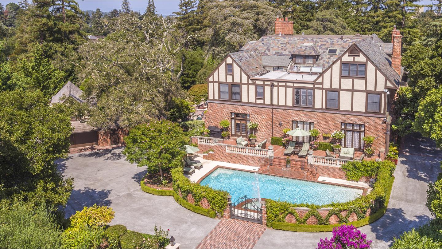 Exclusive must-see listing! Impeccably maintained 1.73ac+/- Tudor-style estate constructed with 19th century detail craftsmanship. The expansive 10,510sf+/- home and 1,800sf basement includes 6bds/8full & 4 half ba plus 2bd/1.5ba guest house has undergone multi-year renovation & extensively modernized/updated! The gated property offers many distinguishing & custom architectural features including beautiful antique oak flooring, paneled walls, lead glass doors, marble fireplaces, detailed crown moldings. cherry wood library, English pub,4500 bottle wine cellar, safe room, finished attic, addtl upstairs family room, 2 staircases, extensive outdoor lighting & sound, professional landscaping w/formal gardens w/ four season color & fruit trees, swimming pool & spa, 2 large terraces, rear service alley.Near 101 & 280 freeways, SFO & San Francisco. Adjacent 0.687ac +/- lot (65 Bridge Rd) is also for sale. Adjacent lot only available for sale after property (119 Bridge) has been sold.