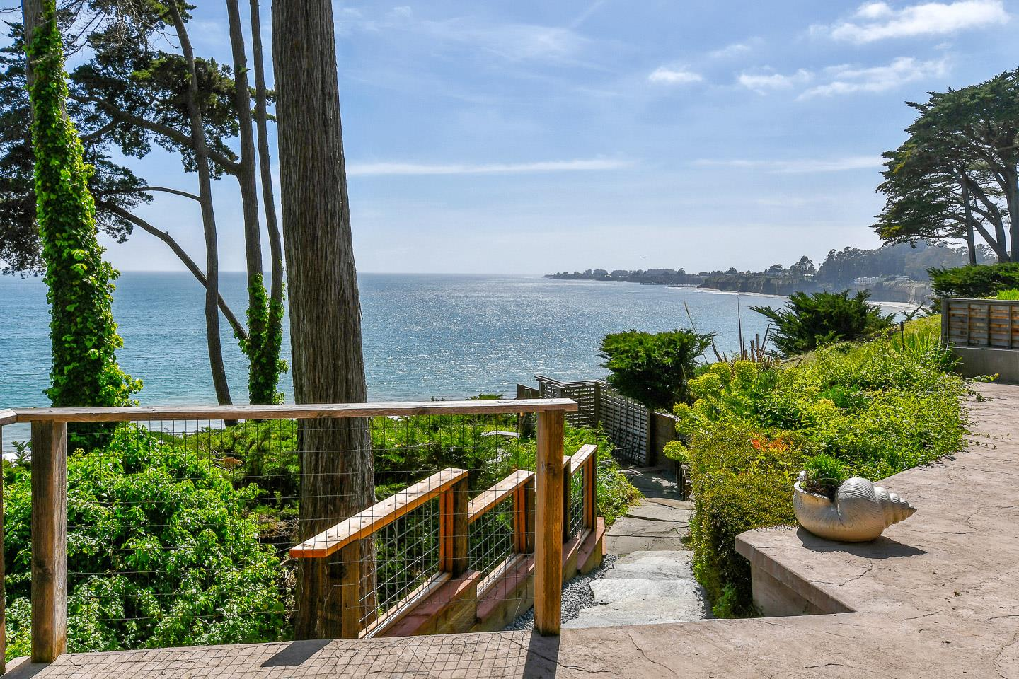 Hear the waves, breathe the salt air and watch the sun set over the Monterey Bay from this 3 bedroom, 3.5 bath gem on the hill overlooking Pot Belly Beach. Spectacular panoramic view of the Bay from floor to ceiling windows and French doors in living room, dining room and master bedroom - and from the decks, fire pit and hot tub. Deeded access to Pot Belly Beach. Slate floors, luxurious master bath with stone shower and huge tub. Kitchen with quartz countertop, Viking range and wine cooler. Spiral stairs to loft with private bedroom and half bath. Private road with gated entry. Perfect location in mid-County Santa Cruz - easy freeway access, adjacent to New Brighton State Beach, around the corner from Capitola. It's an easy drive to Santa Cruz, Monterey or Carmel. And if flying is your preference, it's only 20 minutes to Watsonville Airport. Sellers' home for many years that is now a short term vacation rental. Buyers must be willing to participate in 1031 exchange.