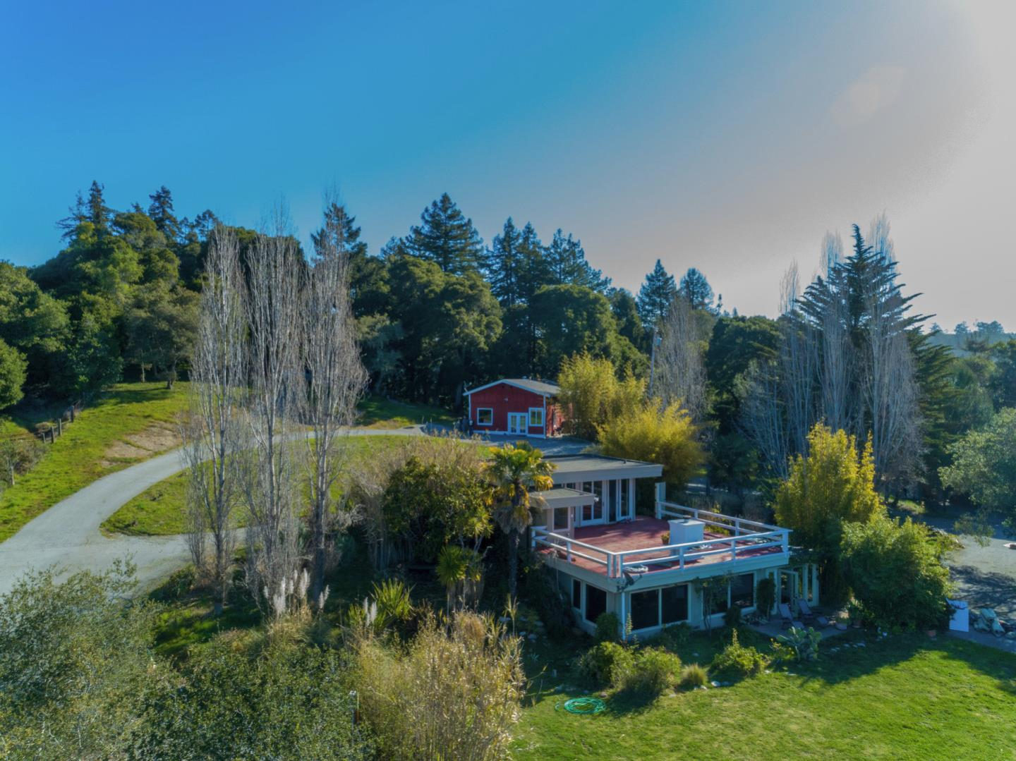 Rare Ocean View Property! Beautiful, one-of-a kind setting with breathtaking ocean views on 6.4 bucolic acres of privacy, pastures and woods.  Highly desired location, approx. 1/2 mile in just before the main kiosk of Nisene Marks State Park! Property includes a lovely 2 bed 2 bath main home with gorgeous vista views and a separate repurposed barn including office area, lounge & extra storage. Excellent landscaped yard, ample gardening spaces, large carport and a wonderful ocean view RV Pad with electricity, running water & septic hookups.  Lower pasture of approximately 4.5 acres offers fantastic potential for horses, livestock or agricultural use. This is truly an amazing property and a rare opportunity, well suited to outdoor enthusiasts or anyone looking for an iconic spot to call home; close to all Aptos amenities and a last stop before 10,000 acres of State Park land & miles of local trails.