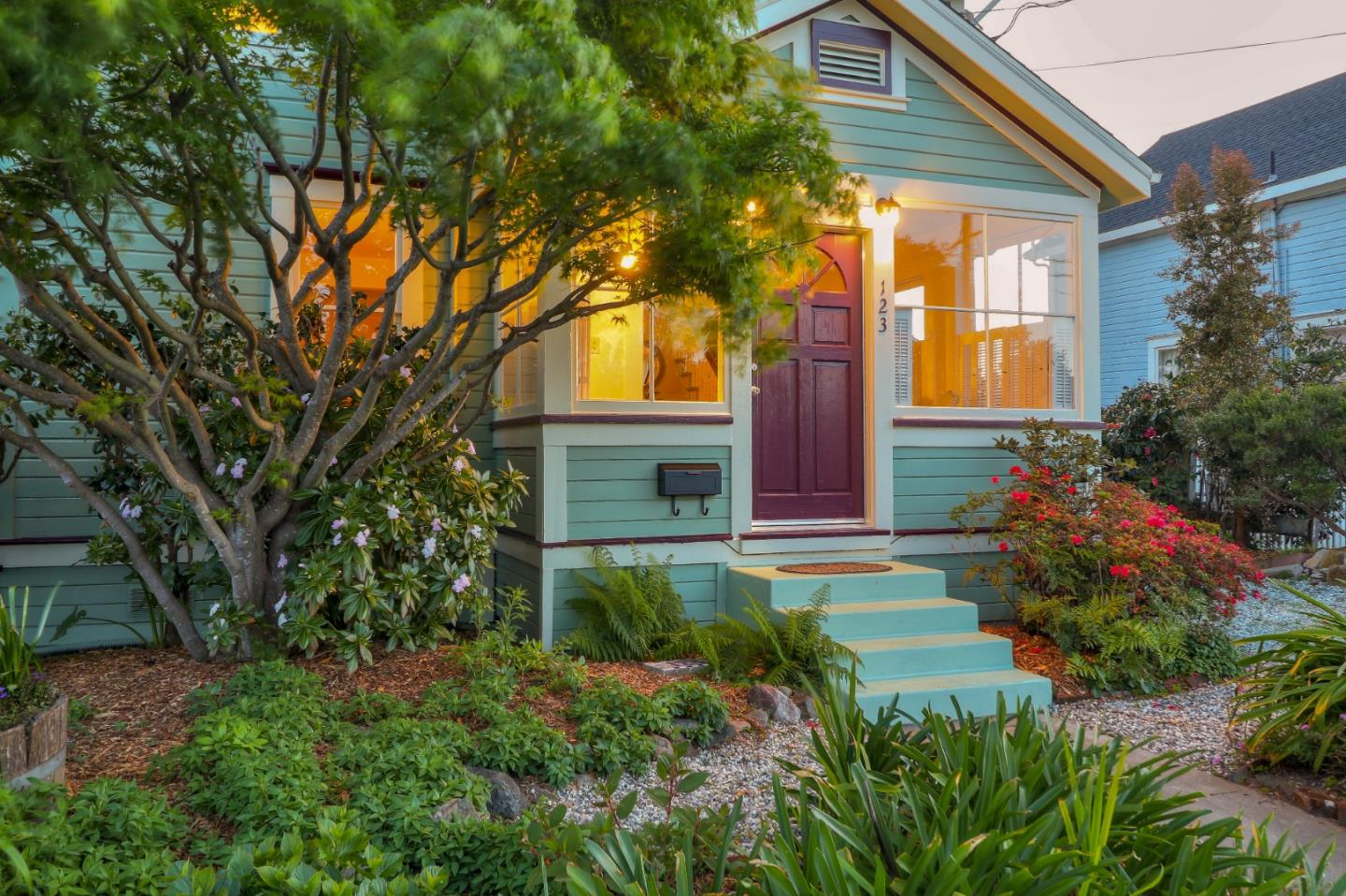 This charming Victorian home in West Side Santa Cruz offers character, vintage details, and unique garden spaces with year-round blooms. The ground floor includes a well-lit living room, dining area, fully equipped kitchen, and garden-view office space. Upstairs there are three spacious, light-filled bedrooms. A modern first-floor addition with separate entrance could be a master suite, in-law unit or guest quarters. There are three modern, full bathrooms, solar hot water, central forced air heating, and warming radiant floor heating in the new addition. The living room opens through French doors to a spacious side porch overlooking a peaceful garden area. The backyard features a secluded, trellis-shaded patio plus redwood deck, fruit trees, raised beds, and a large storage shed. This quiet neighborhood is close to Mission Street restaurants and West Side wine bars, breweries, and beaches.
