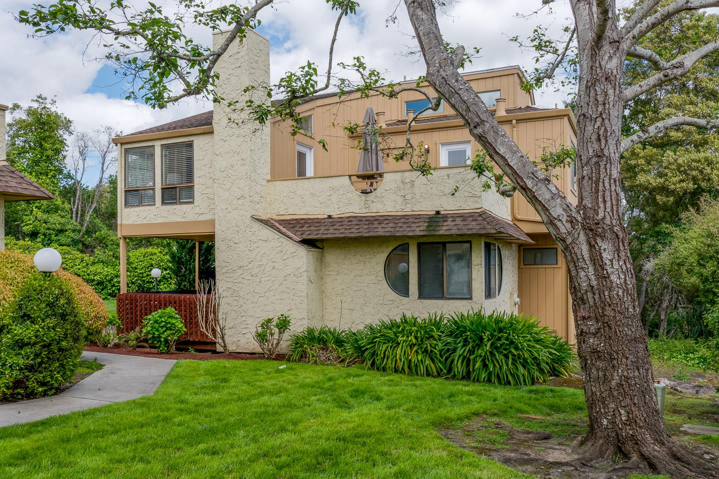 Are you ready to enjoy the relaxed coastal lifestyle? This Mediterranean style townhome is designed to let in the sunshine and sea breezes and is an ideal second or primary home. Come delight in the beautiful ocean views out to Rio Del Mar Beach and the Monterey Bay. The reverse floor plan in this desirable end-unit features a spacious upstairs kitchen, dining room and living area. The high ceilings and large windows provide abundant natural light and add to the airy, open feel. The kitchen and living area lead out to a large balcony, perfect for outdoor dining and sunset happy hours. An additional room was added upstairs (with permits) that is perfect for a third bedroom or home office. This home has been loved for many years and is ready for a new owner to put their personal touch. This clean, comfortable, home offers privacy, easy upkeep, and a great location convenient to Rio del Mar and Seacliff Beach, Nisene Marks, and Aptos shops and restaurants.