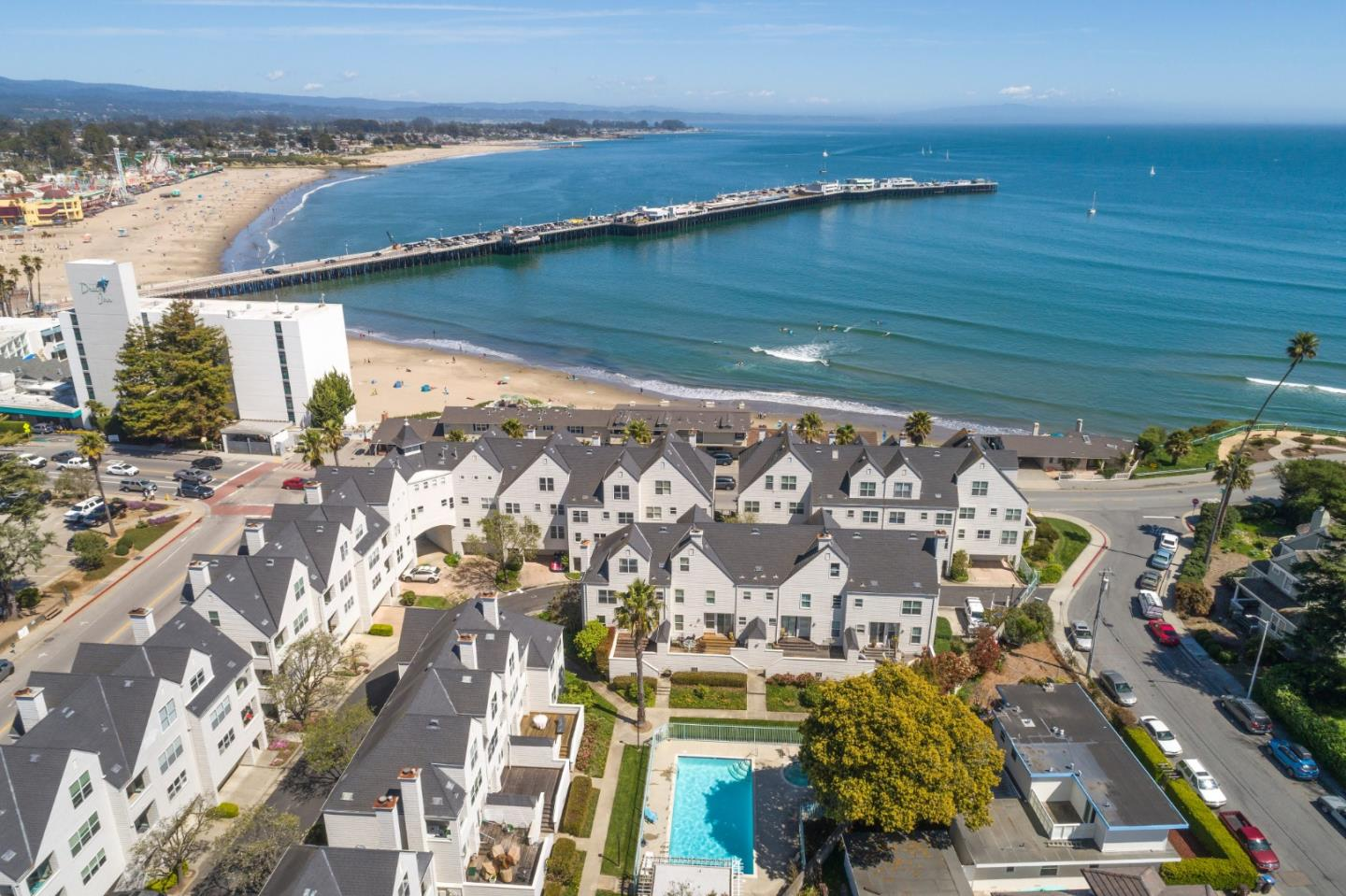 Rare Opportunity to Own in One of the Most Prestigious and Sought After Areas in Santa Cruz on West Cliff Drive. This beautifully remodeled townhouse in a gated community has the largest floor plan - 2590 sq ft with spectacular views of the ocean, the wharf, the beach and the boardwalk!  Experience resort style living with gentle ocean breezes and views as you enjoy the great sunsets! You're steps away from the beach with panoramic ocean views. Close to the beach boardwalk yet far enough for quiet relaxation. Bright, open floor plan with new beautiful wood laminate floors, quartz counter tops in the kitchen and baths, new stainless steel appliances, fixtures and interior paint. This exceptional home with a huge loft on the top level which can be used as a 4th bedroom with a living area, has stunning views of the ocean.  An excellent option as your primary or vacation home! In-unit laundry and a 2-car attached garage. Ready, move-in condition. Enjoy the lifestyle of your dreams!