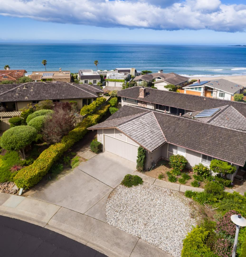 "LOCATION, LOCATION,  LOCATION! SPACIOUS 3 BEDROOM 3 BATH OCEAN VIEW HOME IN THE GATED ""SEASCAPE BEACH ESTATES"" DEVELOPMENT IN APTOS. THIS SINGLE LEVEL HOME SITS ON A 10,542 SQ. FT LOT.  ENJOY THE WAVES BREAKING AND THE MAGNIFICENT SUNSETS!"