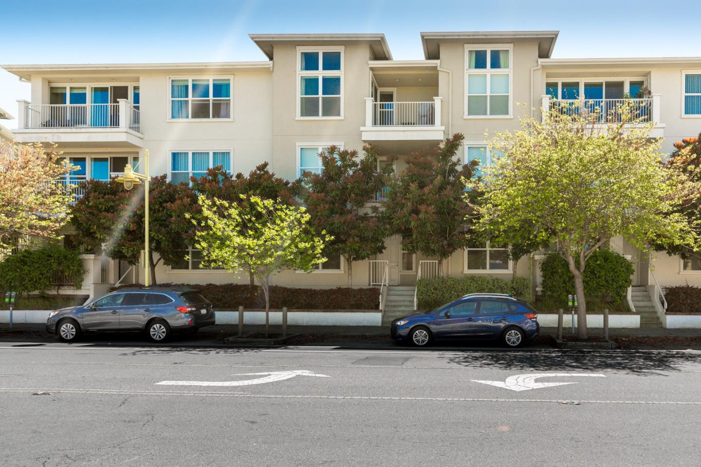 Downtown living at its best.  Active living at its best.  Great commute location too. Leave your car in the garage and enjoy a stroll to your favorite restaurants or movie theaters.  Google and Apple bus stops are near by.  This coastal condo community has it all with a pool, spa, elevator, secured garage and bicycle parking.  Inside, the unit has sleek black counter tops balanced with light stained bamboo floors.  Bedrooms are carpeted and bathrooms have marble tile.  This unit comes with a storage area and 2 parking spaces.  This ground floor condo has the convenience of having 2 doors--one directly accessing River Street and the other to the community courtyard.  Come see and experience resort-like living in downtown Santa Cruz!