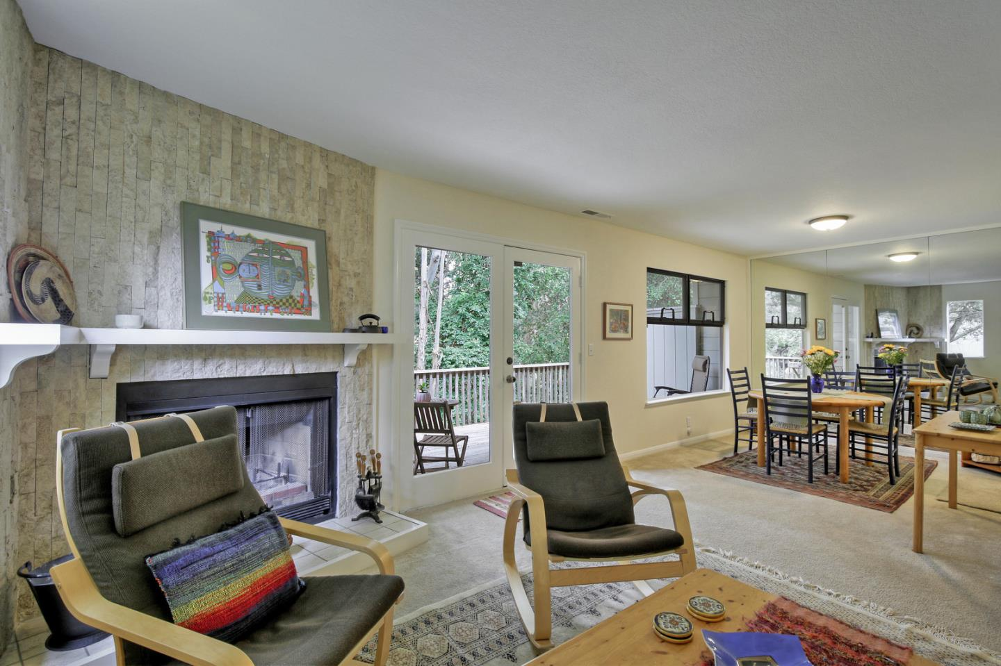 Wonderful end unit location with greenbelt views. The attached 1 car garage at street level offers parking and ample storage. Walk in through the garage to the sprawling three level home. Downstairs has great separation of space with an eat in kitchen, separate dining area and cozy living room complete with a fireplace. The double glass doors lead to the deck where you can relax and enjoy the greenbelt views and wildlife...The second floor has the master bedroom, also with an attached deck and beautiful greenbelt views, a walk in closet and bathroom with a jacuzzi tub and garden window. Oh so relaxing...a second bedroom and bathroom also occupy the second floor. Making our way to the top... The top floor is flooded with light the bonus space could be used as a 3rd bedroom, office, art room or guest space. County shows 2 bedrooms, but lives like the 3 bedroom floor plans. This home is close to shopping, dining, bus lines, HWY 1, medical facilities and more. Great home, great location!