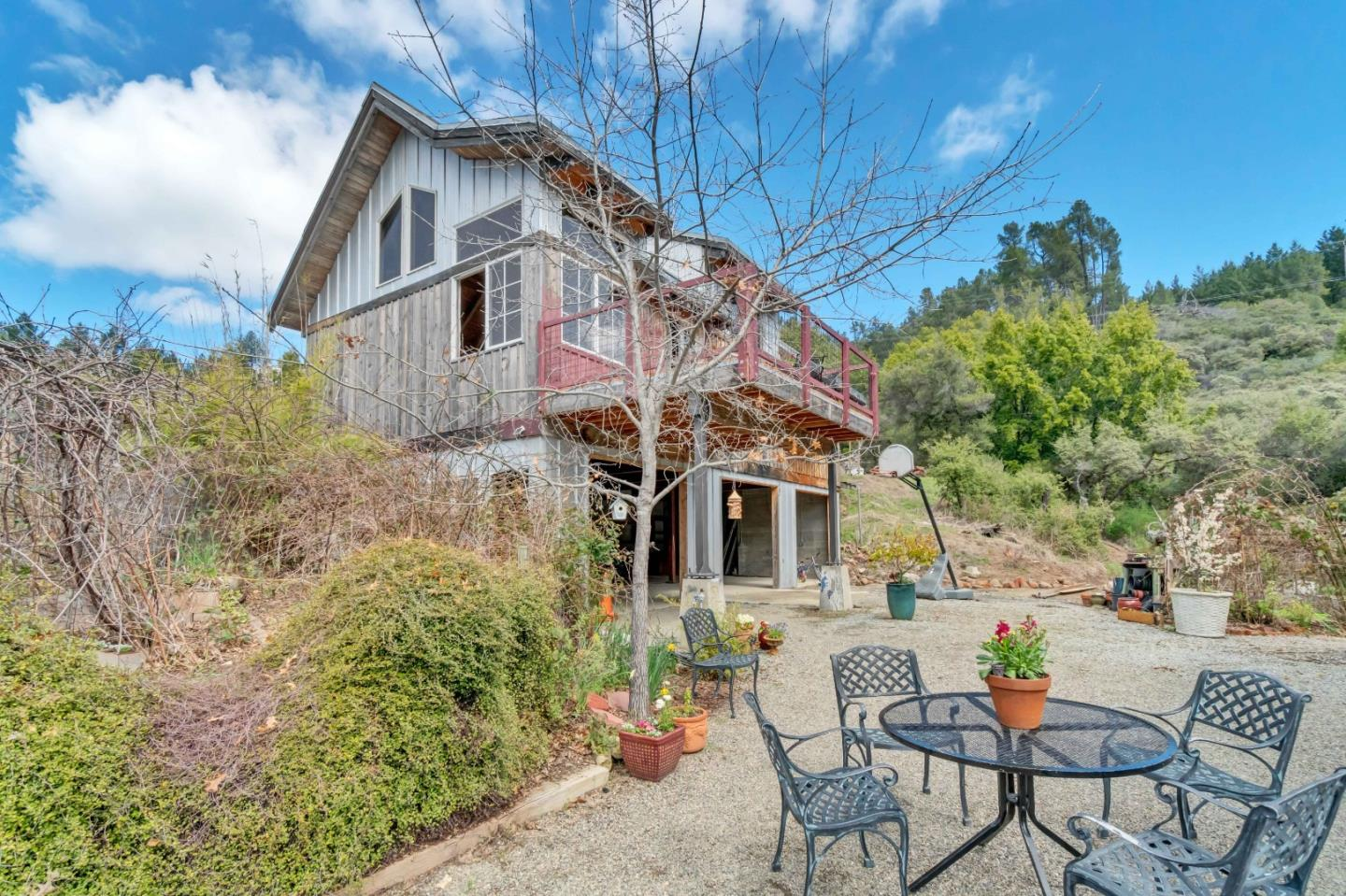 Welcome to paradise, 25 minutes from Los Gatos! Possible owner financing available, special use zones.  Over 77 acres of ocean view opportunity located in the Santa Cruz mountains.  Surrounded by several other mountain vineyards, an abundance of mature fruit trees and beautiful gardens and within walking distance to the Loma Prieta Winery. Room for 4000+ sqft property and harvest-able lumber galore!  3 permitted structures, current guest house almost 75% complete with permits and includes hydronic heating, vaulted ceilings, ocean views, etc. Over 2 miles of cut out hiking or biking trails that back up to the famous Demonstration biking and hiking forest. Options: Winery, Air BB cash cow, solar income, water entity, horse camps, private family estate, retreat center, culinary school, health/spiritual center, spa and more.  Well produces over 100 gallons a minute of water flow and produced over 1 million gallons sold last year.