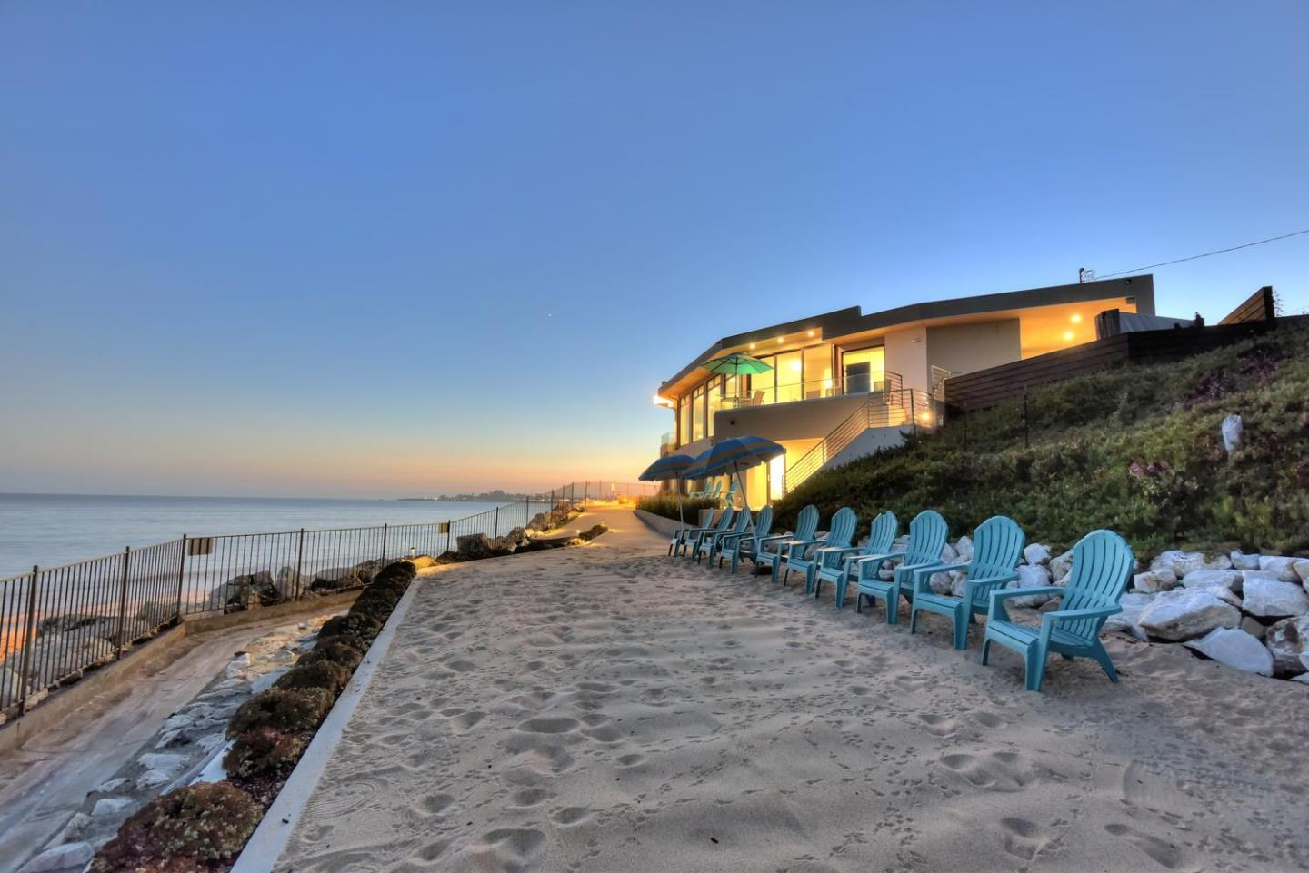 One of a Kind Contemporary Oceanfront Luxury Home on over 500 linear feet of beach front w/breathtaking 240 degree views from expansive floor to ceiling windows. This home has been completely remodeled & is truly one of the finest beachfront properties in all of Santa Cruz! Situated on ¾ acre private point location with remarkable beach & lighthouse views from nearly every room! The spacious floor plan offers something for everyone -  an incredible gourmet kitchen, an atrium style game room, connecting to an outdoor BBQ area, & relaxing oceanfront hot tub. Each bedroom has an attached bathroom, along with surf & sand views! The suite downstairs has its own private entrance w/ 2nd kitchen, LR, bedroom & bathroom. Outside, your own private sandy beach area. A Locked gate conveniently allows easy access to the surf & sand of the public beach. Unbeatable location! The harbor fun is just a beach stroll away. Enjoy all that Santa Cruz has to offer, in the most amazing home in Santa Cruz!