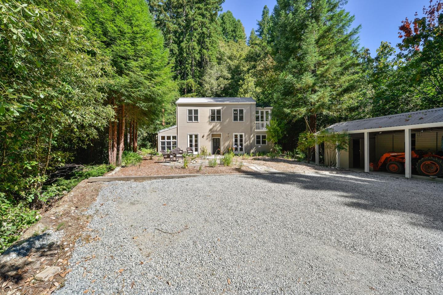 Beautiful custom built home on 10+- acres. Extremely private. Gorgeous redwoods all around. Could be a 4 bedroom home. Beautiful built-ins and French doors in every room. Heated tile floors. Custom tile throughout. Office with separate entrance. Sunny, grassy yard with flowers. Creek on property.