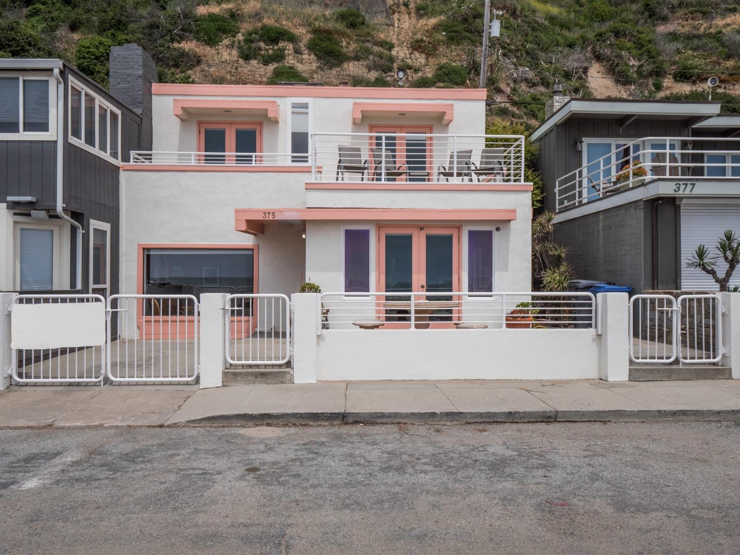 Beach living at its best!  Make yourself at home in this charming 3 bedroom, 2 bath ocean front home.  Enjoy morning coffee outside on the front patio.  See the ocean and sand, hear the waves, watch the sunrise on Monterey Bay.  The upstairs deck offers panoramic ocean views from Pleasure Point to Pacific Grove for your evening enjoyment and sunsets.  This is a coveted located at one of the most desirable area beaches; Rio Del Mar Beach.  Enjoy long walks on the sand to Capitola and La Selva.  Its a short stroll to nearby coffee shop, restaurant, grocery, and deli.  Make your own fun and memories at this beach front paradise.  Vacation here or live here.  Currently a fully furnished vacation rental.  Engineered bluff protection which adds to the investment quality.
