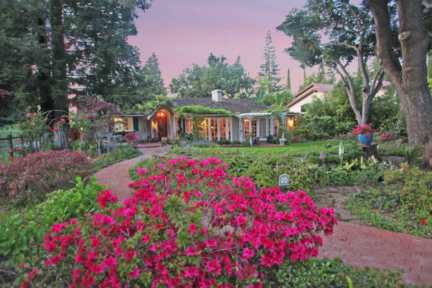 The minute that you pass through the lovely, white, wooden, archway with picket style gates, you will instantly be transported into an idyllic country English setting. Peace and tranquility abound as you admire the stunning landscaping & charm that this property has to offer & quietly escape the hustle and bustle of Silicon Valley. The surroundings are so serene and breathtaking that you will immediately feel like a Thomas Kinkade painting has come to life right before your eyes. 1219 Portland Avenue is a one of a kind property that the current owners have meticulously cultivated and lovingly cared for for more than forty years. With its huge lot size & breathtaking grounds, the possibilities are endless. County records are most likely, incorrect pertaining to square footage, age of home, bedrooms, bathrooms (Buyer to verify). Seller believes that original portion of home may have been built around 1927.  Located in an excellent Los Altos neighborhood w/ top rated Los Altos Schools!
