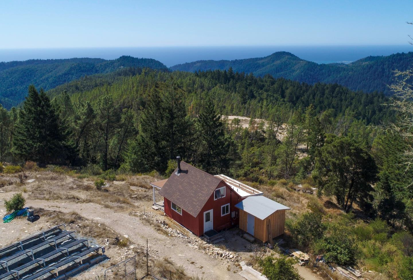Last Chance Road weekend getaway cabin, with extensive ocean views and privacy. Rustic-chic off-grid cabin sits prominently on almost 5 acre lot. 1 bedroom plus sleeping loft. South facing exposure with lots of sun. Rarely do properties become available in this area. Last Chance Road is a unique and eclectic community with a rich history, which offers many possibilities. Recent upgrades include new $75k solar system, just installed with permits, new flooring, paint, kitchen, utility shed to house battery storage. Outstanding sunsets & stargazing, Last Chance road leads from the western boundary of Big Basin State Park, It starts out as a ridge road between Wadell Creek and Scott Creek, the fire road brings you up to the peaks. Property is on Pine Mountain, off Last Chance road, in a chaparral like micro climate, above the fog and the majestic redwood trees. 7 miles on a fire road, approximately 30 minutes from Highway 1. 4wd is recommended.