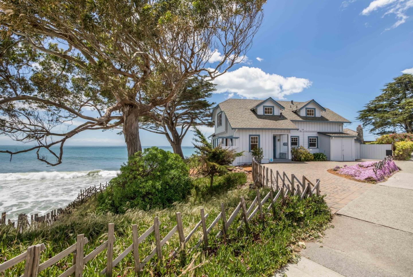 This iconic property is the only home on the ocean side of West Cliff Drive offering a feeling of privacy and seclusion.. This south-facing home offers rare opportunities to experience sunrise and sunset while the ocean crashes at your feet. The nearly half acre lot yields a multitude of small beaches, coves, tidal pools and is adjacent to Getchell's surf break. Conveniently located within walking distance to Boardwalk, Wilder Ranch,and trendy restaurants.  The main residence with its Big Sur like charm has 4 bedrooms and two full baths,combined with the guest studio to accommodate many visitors while the living and social areas of the home are well-suited for entertaining or a serene, private experience. A continuous theme of coastal views is reinforced by the homes position on bluff, surrounded by water, and multiple windows in every room. The grounds of the property feature a private beach terrace with fire pit, outdoor shower and large yard where fantastic events can be hosted.
