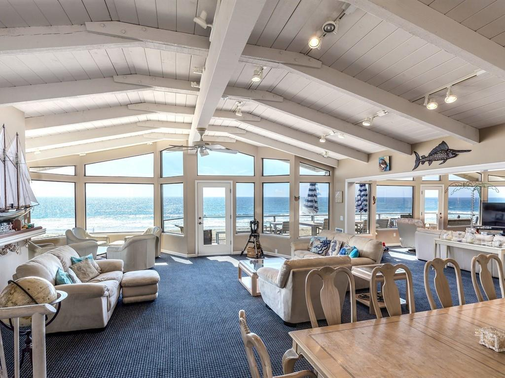 Live in paradise! Beautiful beach front property nestled in a private gated community in Pajaro Dunes. Walk in and have your breath taken away by the amazing wall to wall windows with ocean views. The back deck runs the entire length of the house giving you a magnificent view of a perfect sunset. Enjoy your mornings watching dolphins and other beautiful sea animals right in your backyard. This home includes 2 FULL kitchens, perfect for entertaining and hosting! Two family rooms upstairs along with a pool/ping pong table combo make a perfect recreational space. Walk downstairs into another living area; perfect for kids to play or to lounge! 5 bedrooms which include two master suites and 4.5 bathrooms. This home comes fully furnished. A perfect spot for you to either live in a dream or to invest as the home is currently used as a vacation rental if you have interest in making this an income generator. The perfect vacation home just an hour from the heart of Silicon Valley!