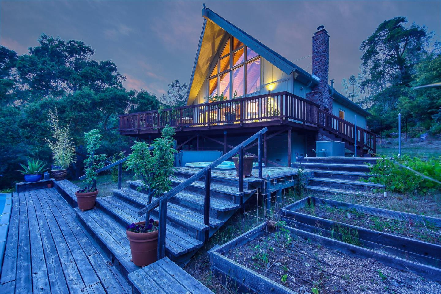 Sunshine and privacy abound at this wonderful mountain chalet in a coveted neighborhood of Bonny Doon approximately 5 miles to the coast and 15 minutes to Santa Cruz. The spacious floor plan features a great room with soaring high ceilings and a wall of windows overlooking the beautiful oak studded grounds. There are two comfortable bedrooms plus a large office that could serve as a family room or additional guest space. Outside, the wrap around deck extends the living space seamlessly creating an ideal venue for entertaining or simply enjoying the good life in the Santa Cruz Mountains. Backing up the Bonny Doon Ecological Reserve, there's a wonderful sense of space on the .95 acre parcel with plenty of room to garden, go for a swim, or relax in the brand new hot tub.