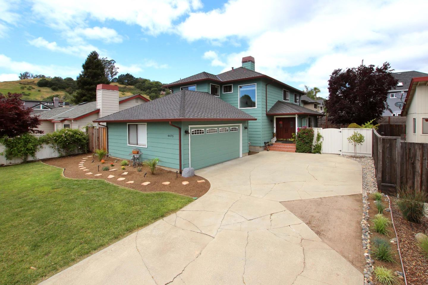 A stunning presentation of this home located in the Evergreen Estates community awaits your discerning eyes. With its bright and airy open floor plan inside, this wonderful home is complemented by the rear yards stylish design with a focus on entertainment. From the moment you step through the front door this home reveals itself with views of the living room, family room, kitchen, dining room and that amazing rear yard. The theme of the upstairs living area is one of spaciousness and comfort. Two large bedroom and one huge master suite with a huge walk in closet and spacious master bath with a tub in shower design. And be sure to feel the thick padded carpeting. Its like walking on a cloud. So please allow yourself plenty time to explore this home inside and out. This is a no shoes home so Id suggest shoes that slip on and off easily so you can experience the flooring textures inside and then slip those shoes back on and savor the rear yard and all its distinct areas and amenities.