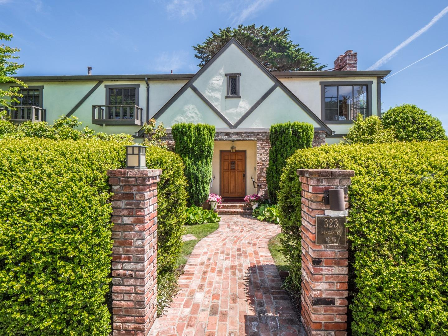Tudor style architecture with an ocean scenic neighborhood mark this property as truly unique.  Enjoy your midday meal with the smell of salt in the air and the tranquil sound of waves beneath you, surrounded by vibrantly colorful gardens.  The interior speaks of craftsman charm, with engaged ceiling beams in the family room, cherry cabinets and mantle in the living room, and ocean views in several rooms of the home.  Your champagne can be chilled in the wet bar.  A master suite offers separate closets and sinks for a couple, as well as an attached deck with the ocean in front of you.  The den has custom cherry cabinets, fireplace, and ocean view..  A huge family room for grand family activities.  The interior has been freshly painted, has new flooring, and refinished wood floors in the kitchen.  The home is conveniently close to the Rio Cafe and a staircase to the beach is just a few blocks away.  Come see what a mix of Tudor style home with our Santa Cruz ocean creates!